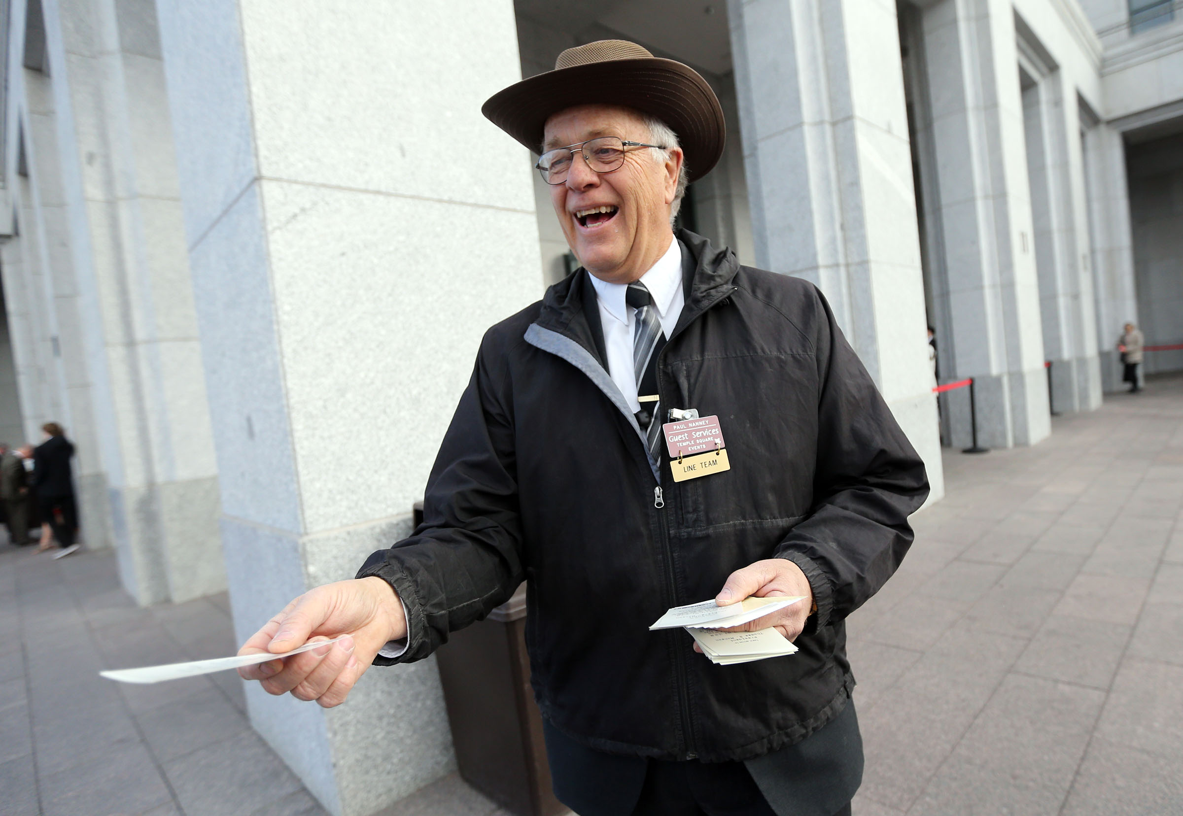Paul Nanney hands out tickets outside of the Conference Center for President Thomas S. Monson's funeral in Salt Lake City on Friday, Jan. 12, 2018.