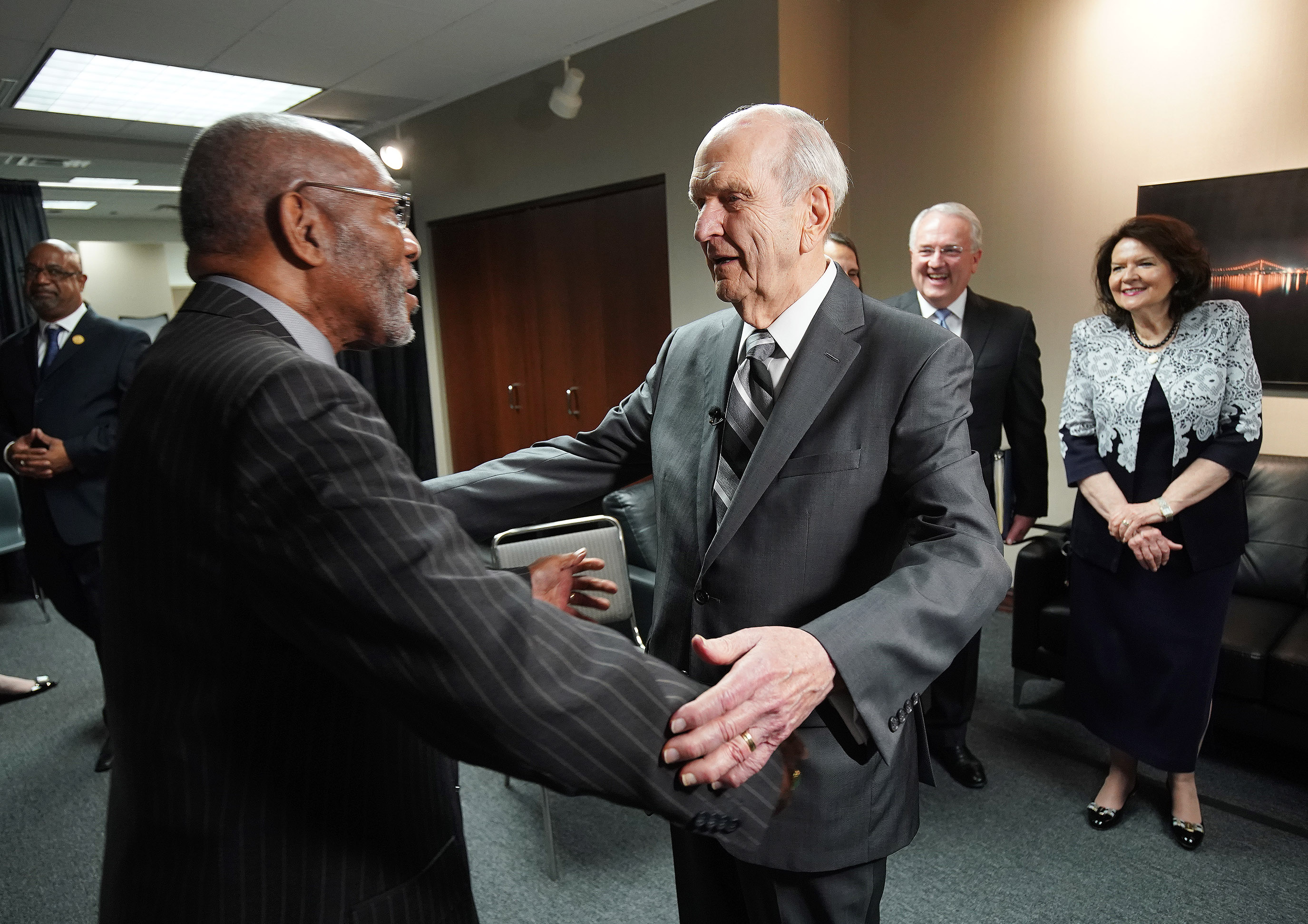 President Russell M. Nelson of The Church of Jesus Christ of Latter-day Saints embraces the Rev. Amos C. Brown at the 110th annual national convention for the National Association for the Advancement of Colored People in Detroit on Sunday, July 21, 2019.