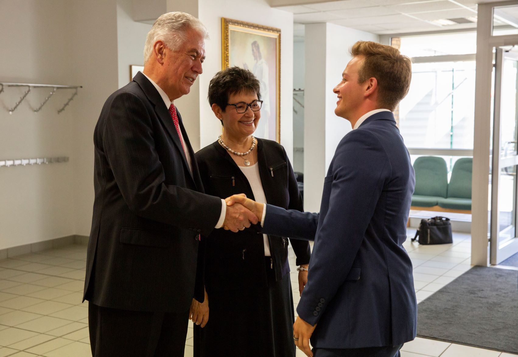 Elder Dieter F. Uchtdorf, left, of the Quorum of the Twelve Apostles, and his wife, Sister Harriet Uchtdorf, greet an elder in conjunction with their participation in a Germany Frankfurt Mission conference in Frankfurt on Sept. 11, 2018.