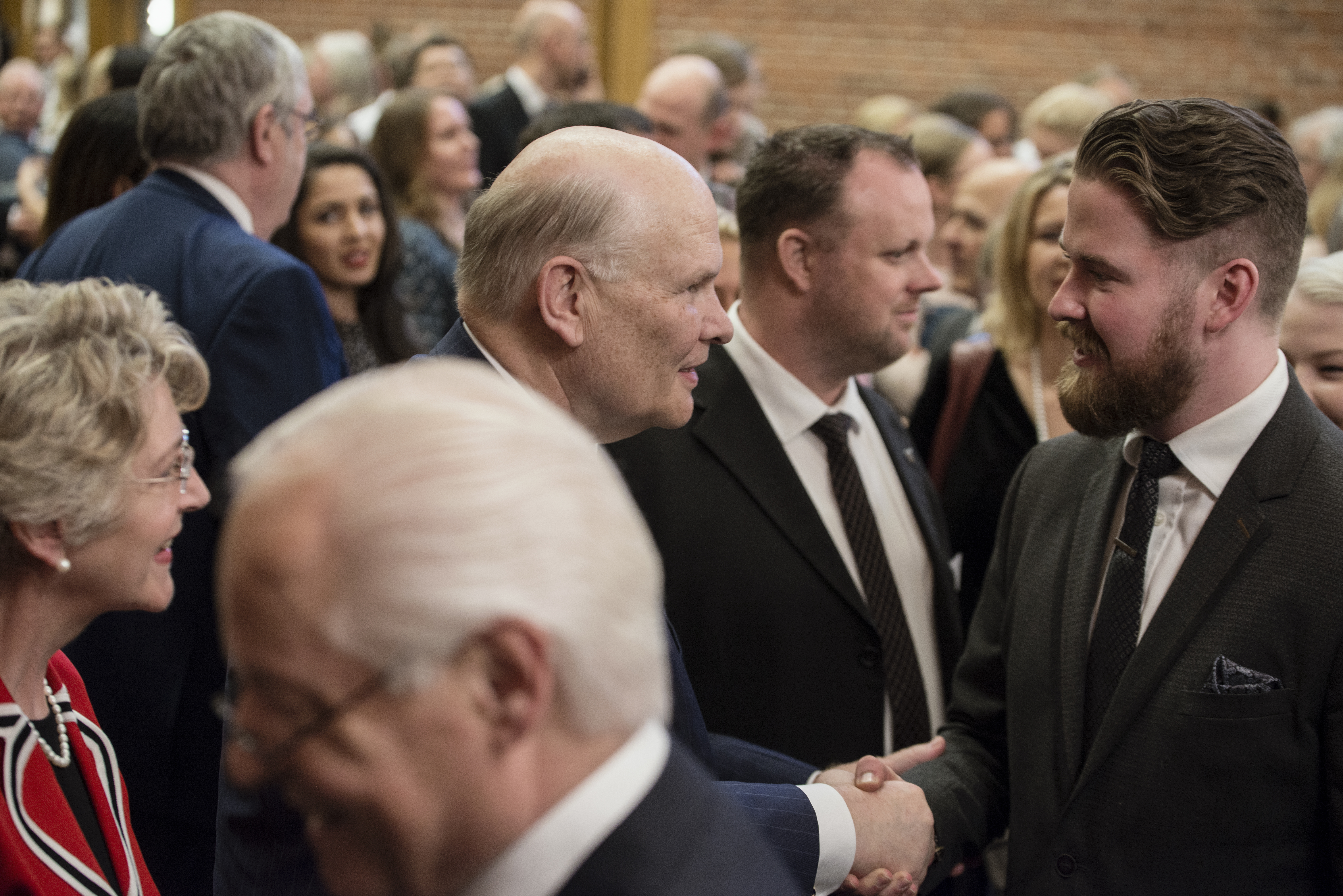 Elder Dale G. Renlund of the Quorum of the Twelve Apostles and his wife, Sister Ruth L. Renlund, visit with Church members in Sweden during a visit to the country on April 29.