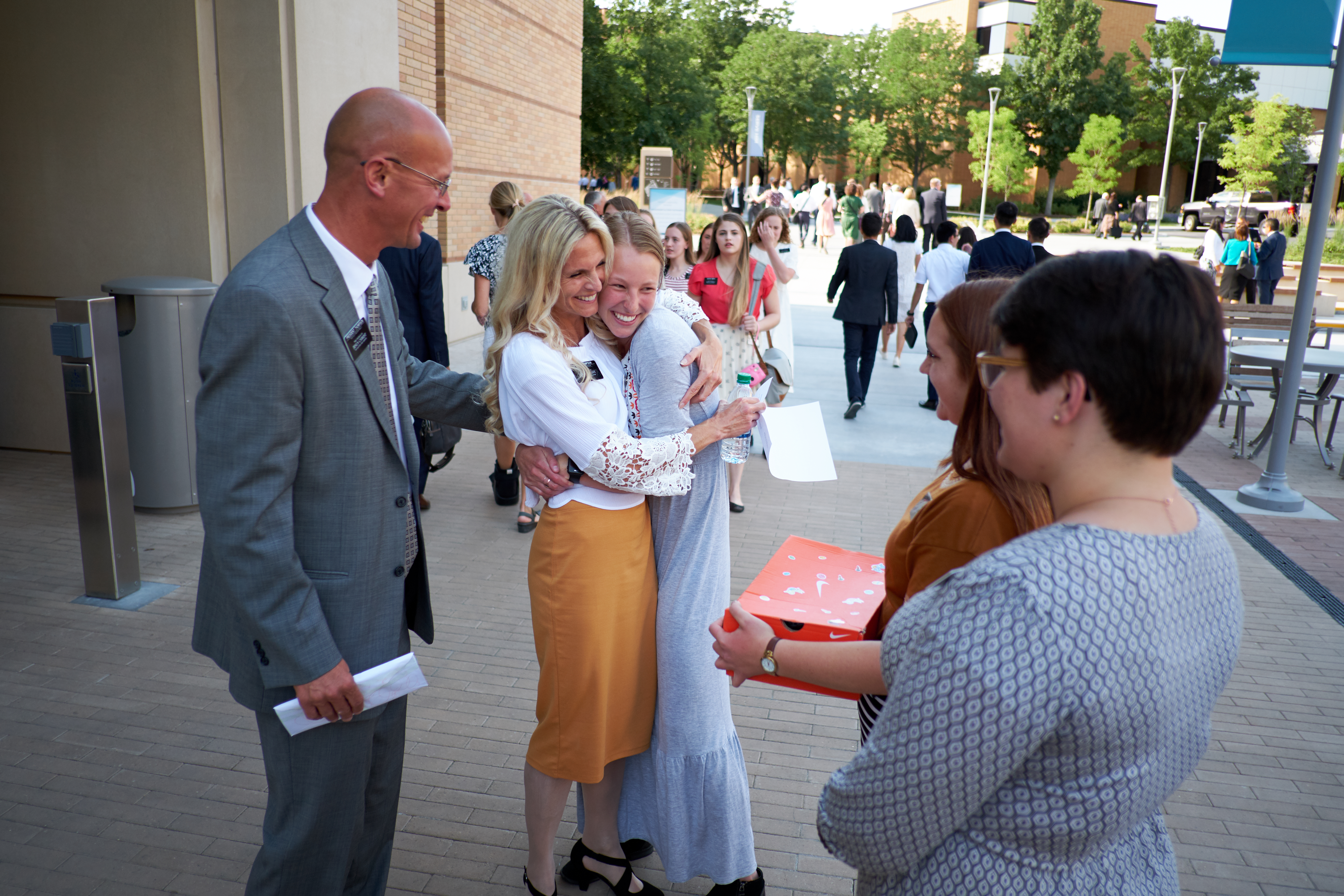 A mission president and his companion greet missionaries at the Provo Missionary Training Center during the 2018 Mission Leadership Seminar on June 24-26.