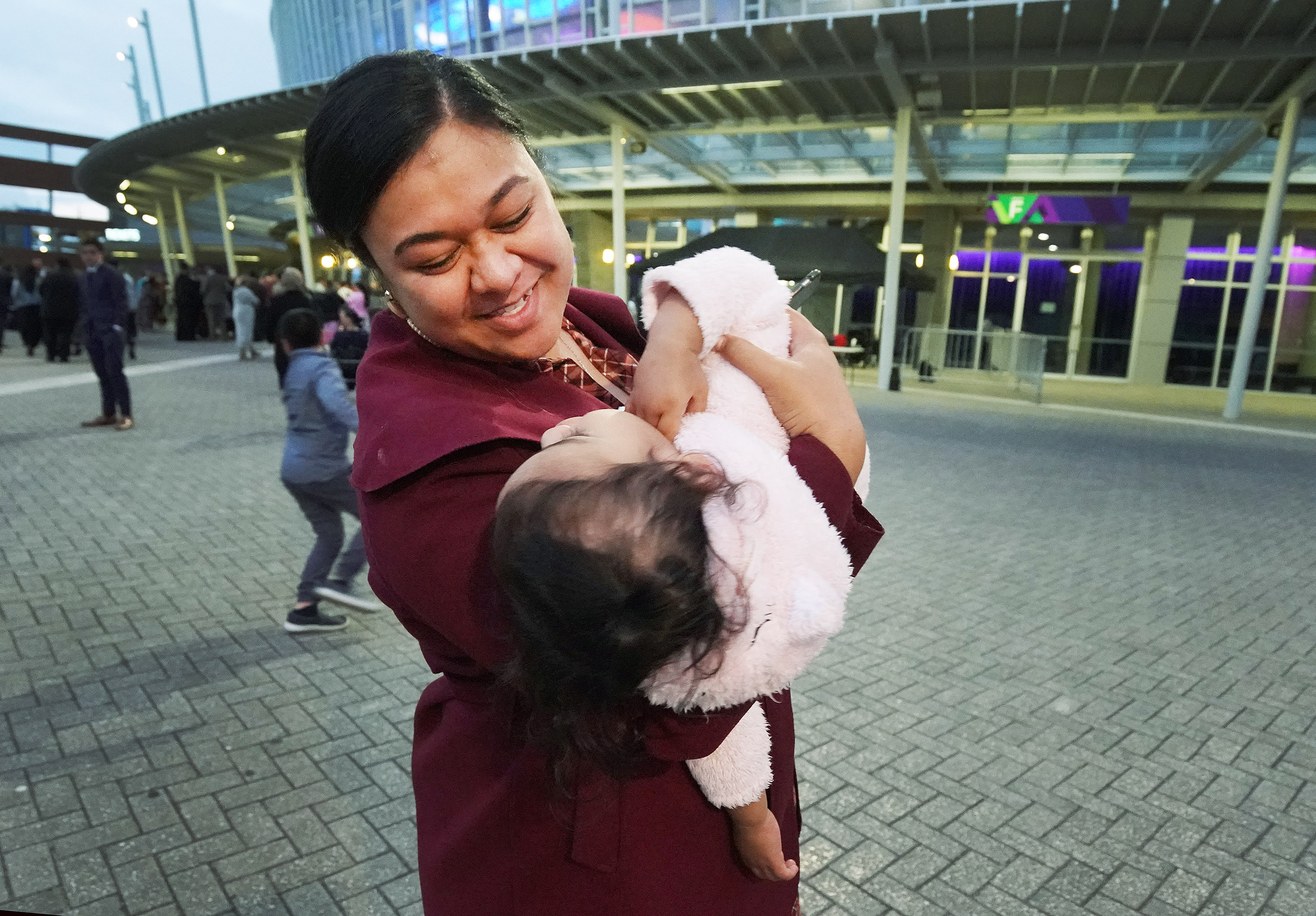 Sylvia Pritchard plays with her niece by the same name — Sylvia Pritchard — prior to a devotional with President Russell M. Nelson of The Church of Jesus Christ of Latter-day Saints at Spark Arena in Auckland, New Zealand on May 21, 2019.