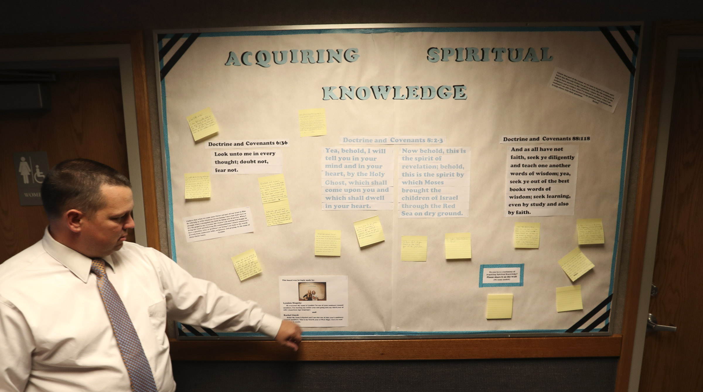 West High seminary principal Trent Smith with a bulletin board dealing with acquiring spiritual knowledge before one of his LDS seminary classes at West High School in Salt Lake City on Monday, Sept. 17, 2018.