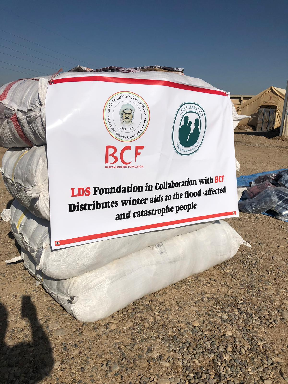 A sign in the Ashti refugee camp shows the cooperative efforts of LDS Charities and the Barzani Charity Foundation to provide providing tents and shelter in several refugee camps in Kurdistan.