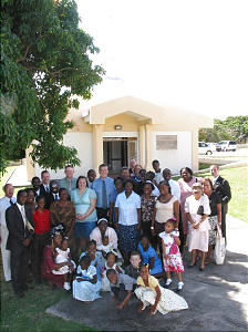 Members in front of St. Kitts Branch meetinghouse after Caribbean area conference broadcast. Meetinghouse was dedicated by President Gordon B. Hinckley on Thursday, Jan. 8, 2004. Photo by Greg Hill.