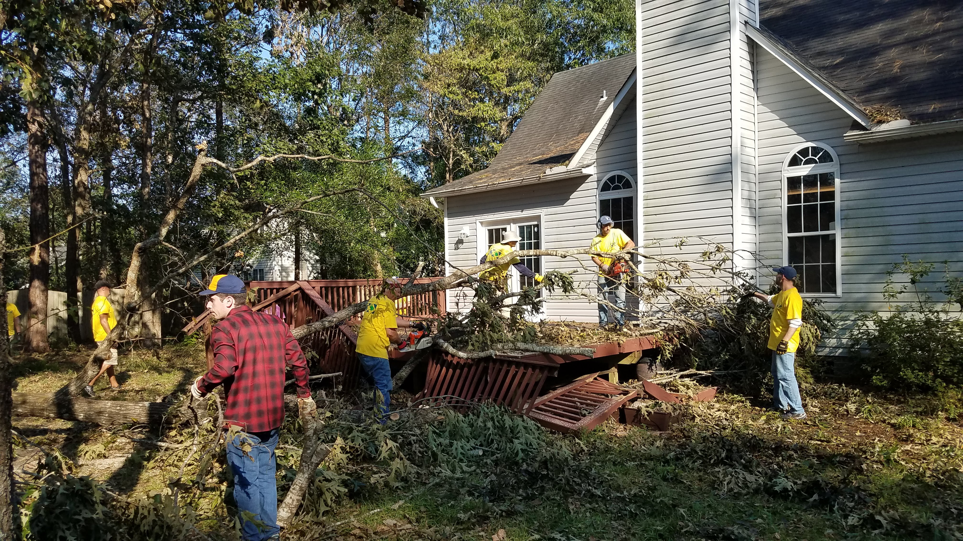 Latter-day Saints clear out debris outside home in Wilmington, North Carolina, following Hurricane Florence.