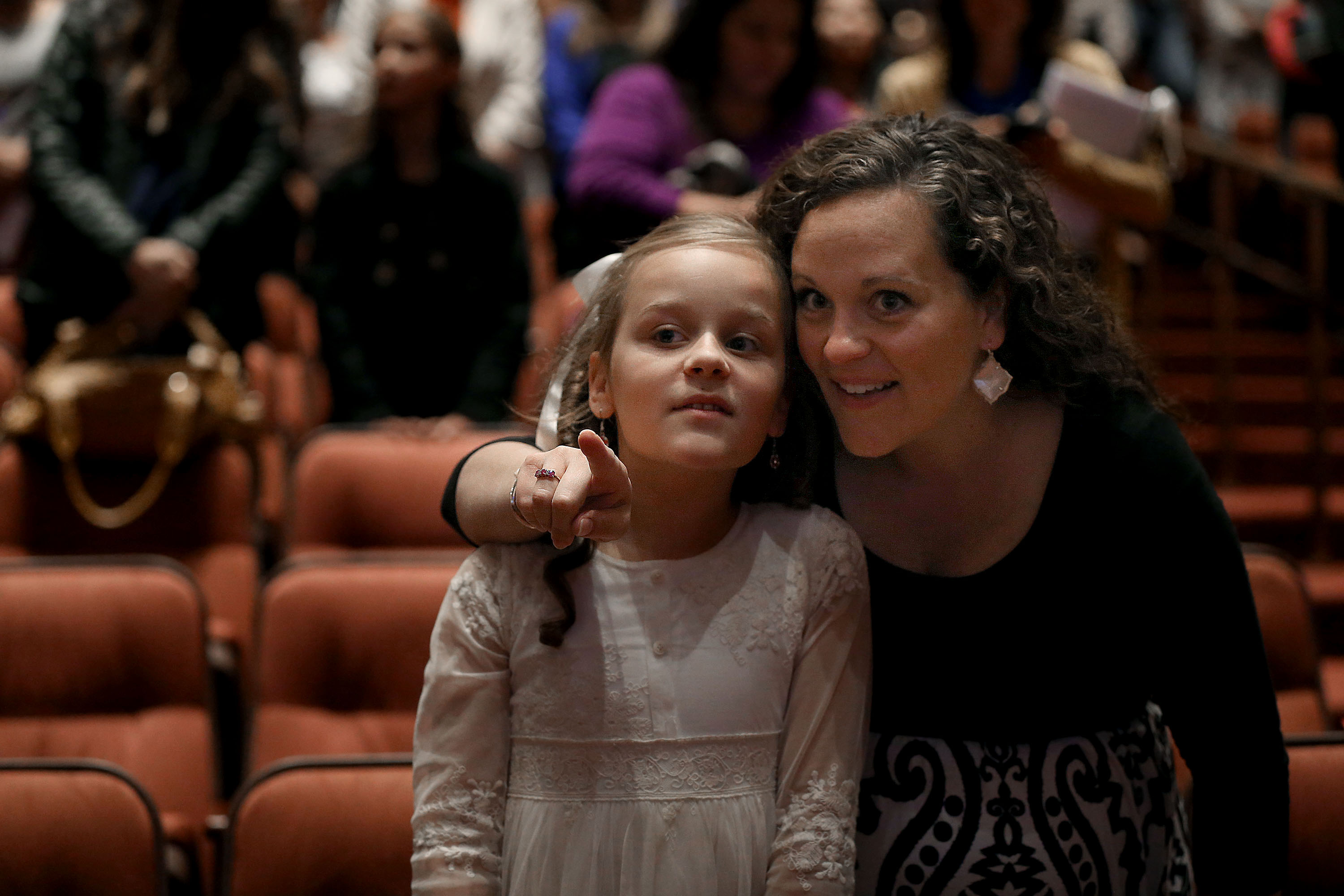 Eliza Van Drimmelen, 10, and her mother, Marquessa, point out church leaders as they enter the general women's session of the 188th Semiannual General Conference of The Church of Jesus Christ of Latter-day Saints held in the Conference Center in downtown Salt Lake City on Saturday, Oct. 6, 2018.