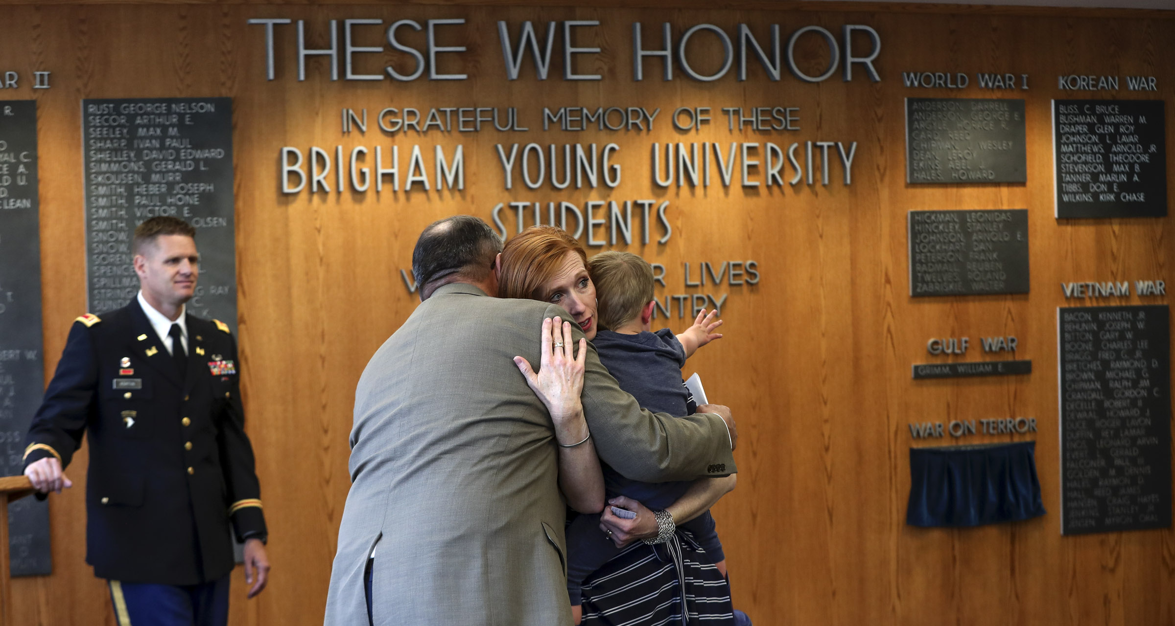 Maj. Gen. Brian L. Tarbet hugs Jennie Taylor during a ceremony where the name of her late husband, Maj. Brent Taylor, was added to the Reflection Room Memorial Wall in the Wilkinson Center on the BYU campus in Provo on Thursday, May 23, 2019. Taylor was killed in Afghanistan in 2018.