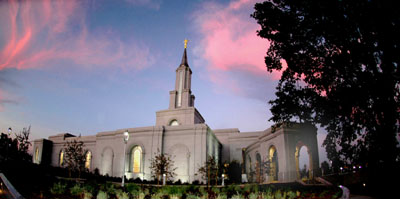 The Sacramento California Temple's spire is accented by a colorful sunset.