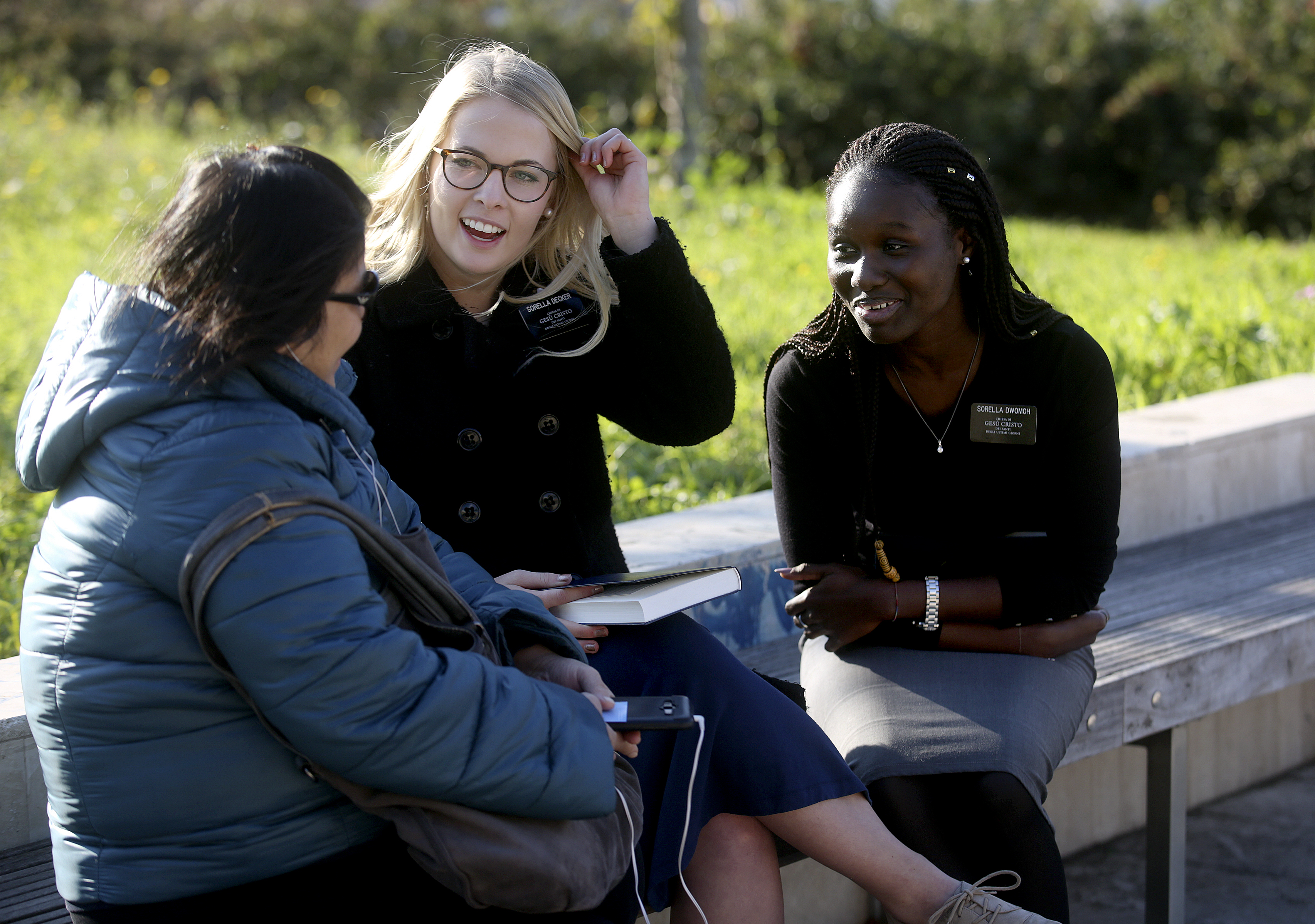 Sister Sadie Decker, center, and Sister Carolyne Dwomoh talk with Rowena Dayandayan, left, as part of their finding efforts in Rome, Italy, on Saturday, Nov. 17, 2018.