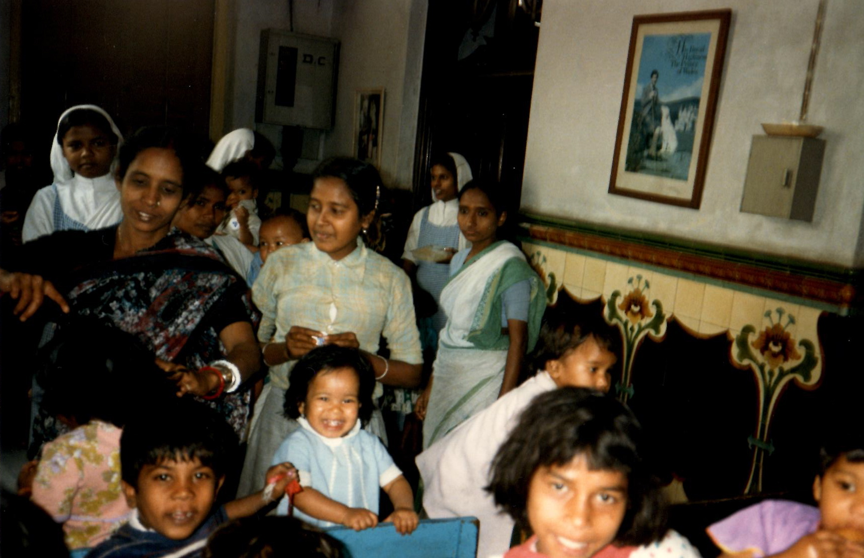 Image from 1986 of children and nuns in a Calcutta, India, orphanage operated by Mother Teresa. The photo was shot during a visit by Brigham Young University's Young Ambassadors.