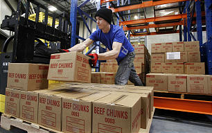 Matt Van loads beef chunks at the new 570,000 square foot Utah Bishops' Central Storehouse in Salt Lake City, Thursday, Jan. 26, 2012.