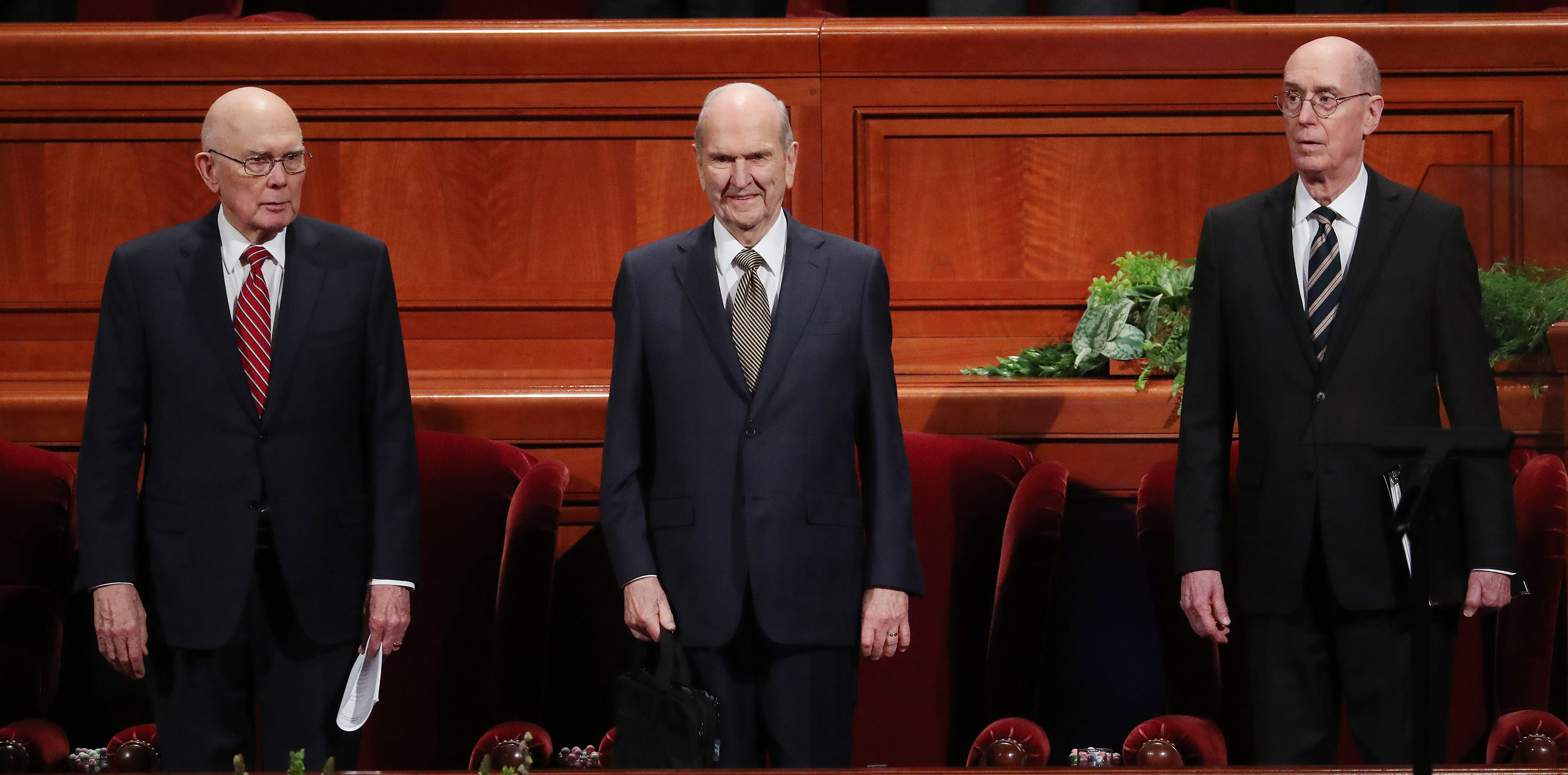President Russell M. Nelson of The Church of Jesus Christ of Latter-day Saints, center, and his counselors, President Dallin H. Oaks, first counselor in the First Presidency, left, and President Henry B. Eyring, second counselor in the First Presidency, right, stand in the Conference Center prior to the 189th Annual General Conference of The Church of Jesus Christ of Latter-day Saints in Salt Lake City on Sunday, April 7, 2019.