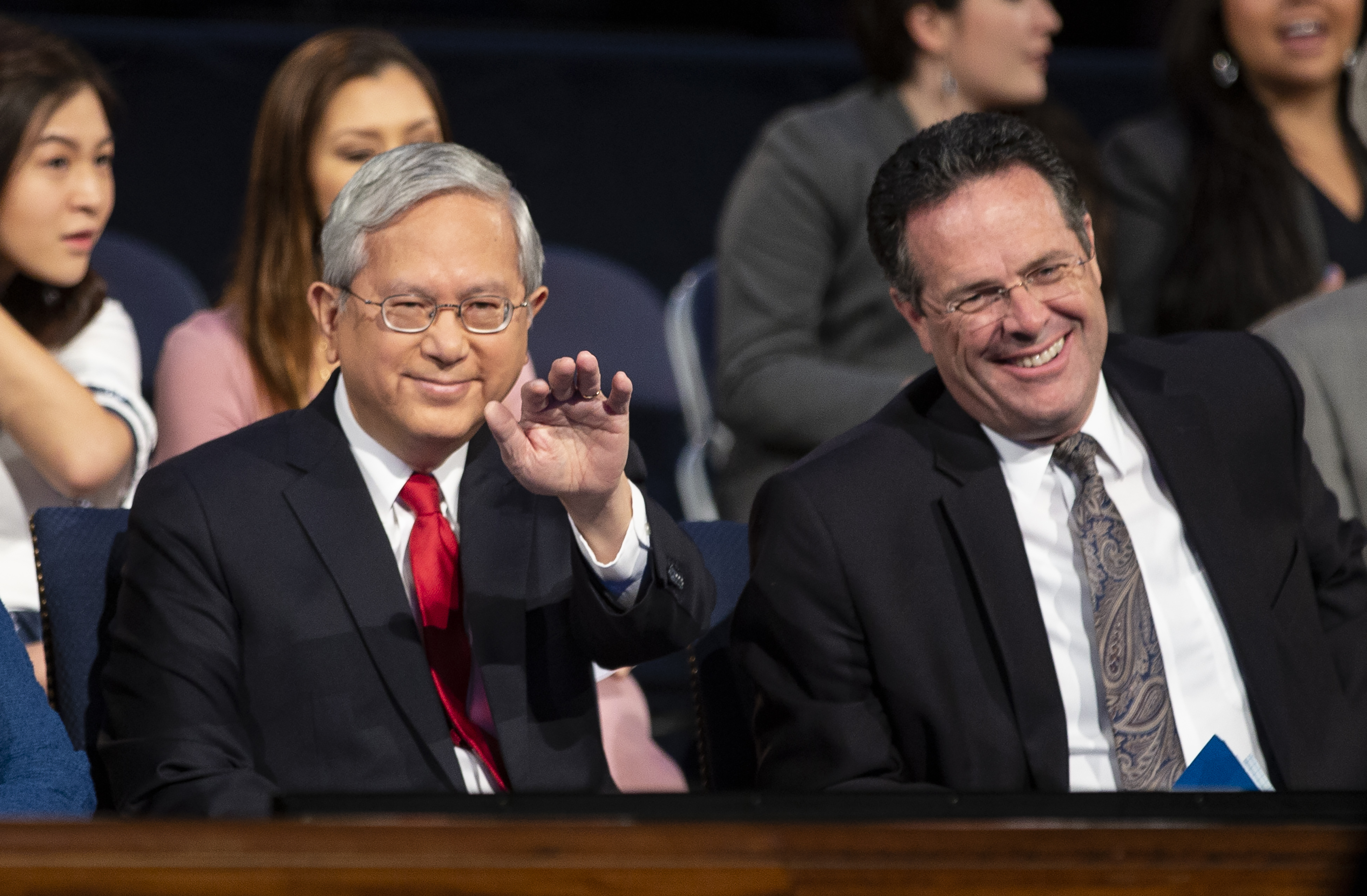 Elder Gerrit W. Gong of the Quorum of the Twelve Apostles waves to someone in the crowd prior to speaking at a BYU campus devotional on Tuesday, Oct. 16, 2018.