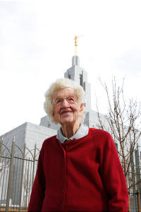 Virginia Lewis stands in front of new Draper Utah Temple.