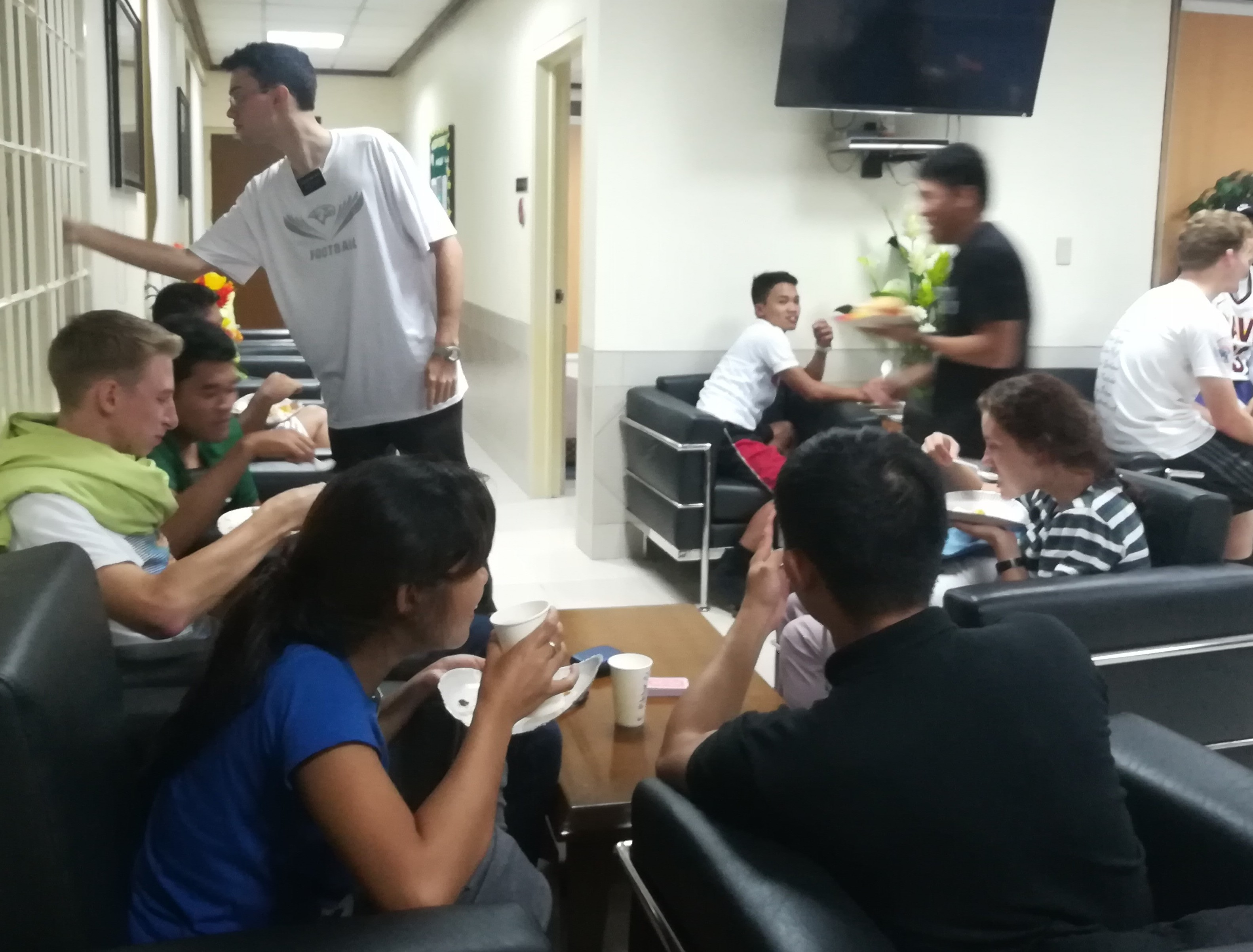 Missionaries in the Philippines enjoy eating and socializing together while sheltered in a meetinghouse during Typhoon Mangkhut.