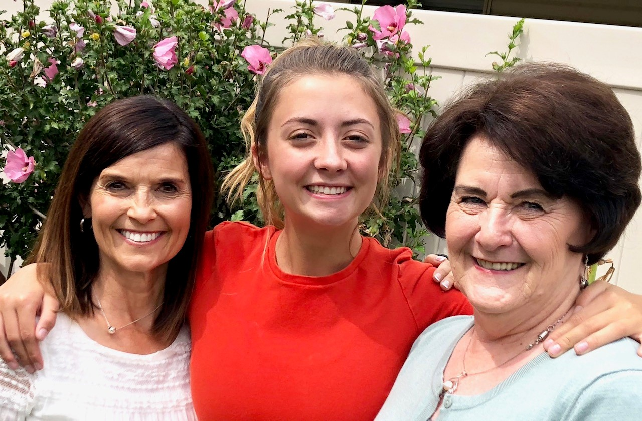 Sister Becky Craven, second counselor in the Young Women general presidency, and her ministering companion, Grace Rogers, visit Carol McIlrath.