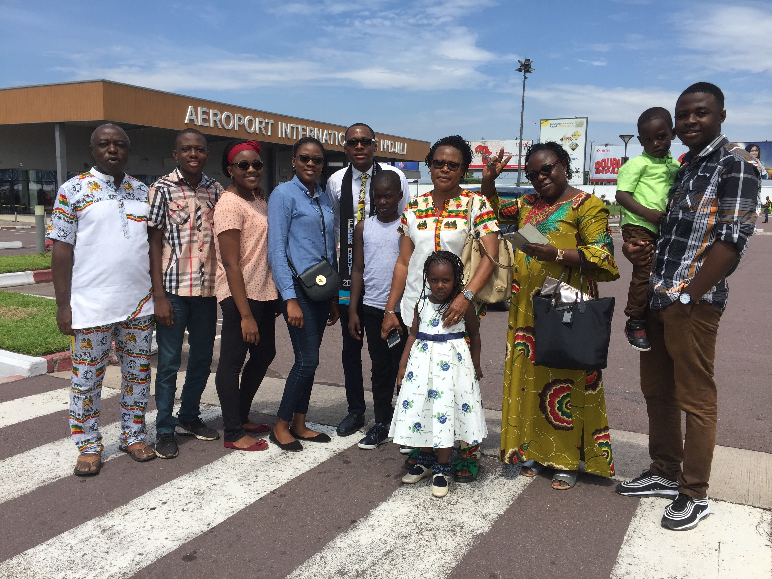 Mbuyi Nkitabungi Dieudonné, left, joins family members in welcoming home a son, Jonathan, following his service as a full-time missionary, in 2019.