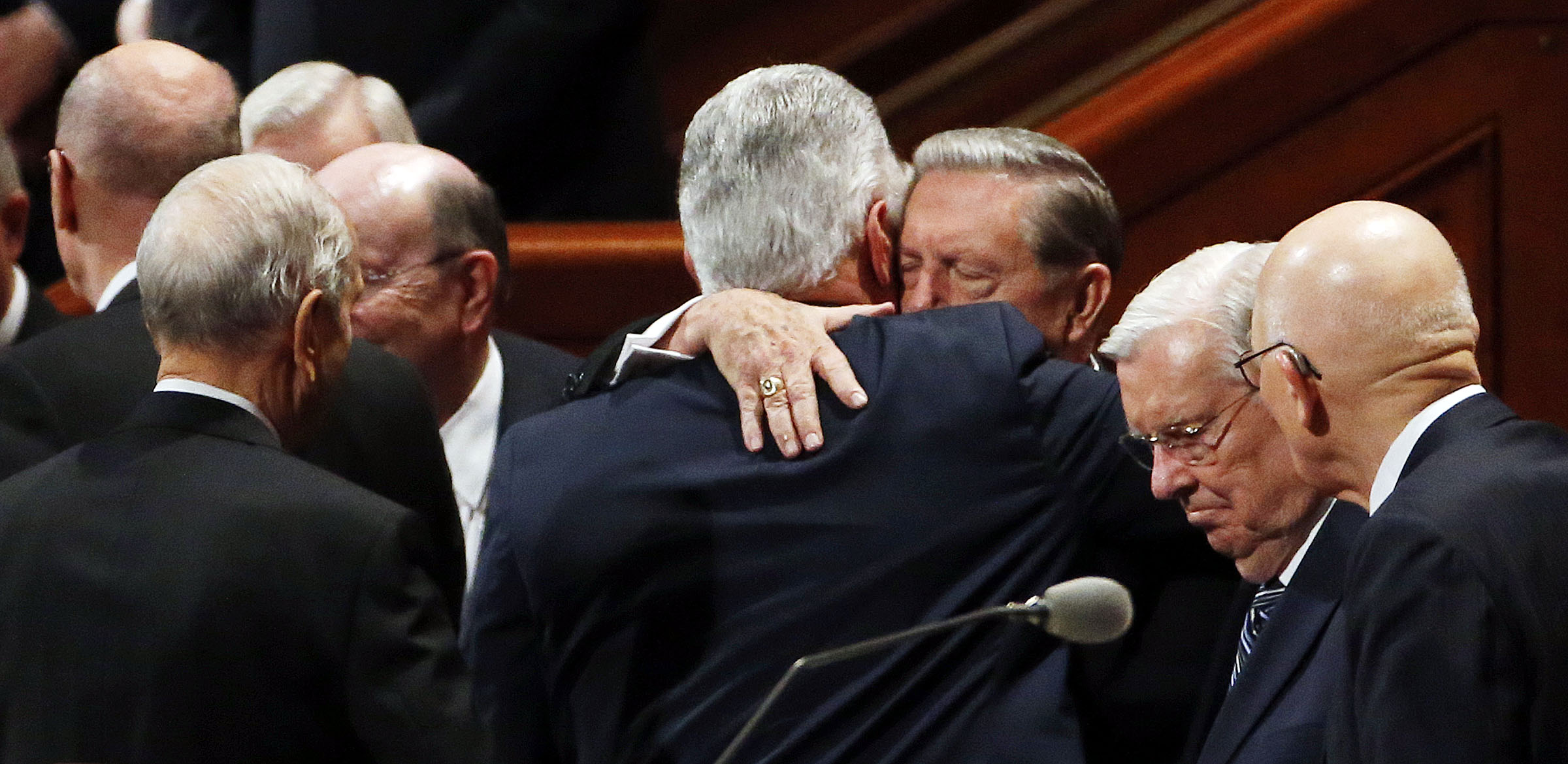 Elder Jeffrey R. Holland hugs President Dieter F. Uchtdorf, back to camera, after the Saturday morning session of the 187th Semiannual General Conference of The Church of Jesus Christ of Latter-day Saints in Salt Lake City on Saturday, Sept. 30, 2017.