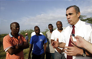 Caribbean Area President Francisco Vinas, right, talks with Port-au-Prince Stake President Francillon Ghemmald, left, and others while assessing Church needs. The Church responded to the disaster in its immediate aftermath.