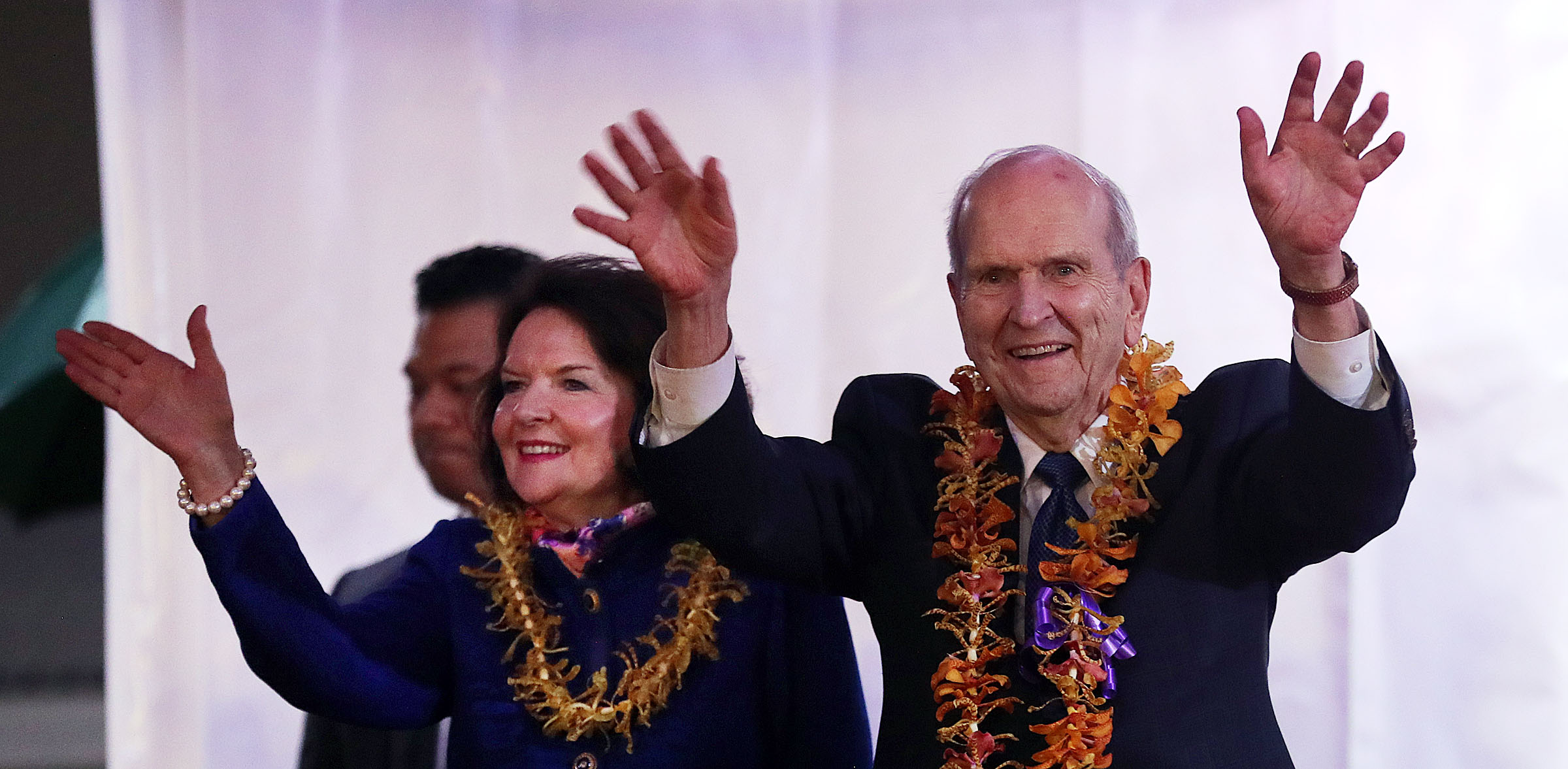 President Russell M. Nelson of The Church of Jesus Christ of Latter-day Saints and his wife, Sister Wendy Nelson, wave to those in attendance at the beginning of a devotional in Apia, Samoa, on Saturday, May 18, 2019.