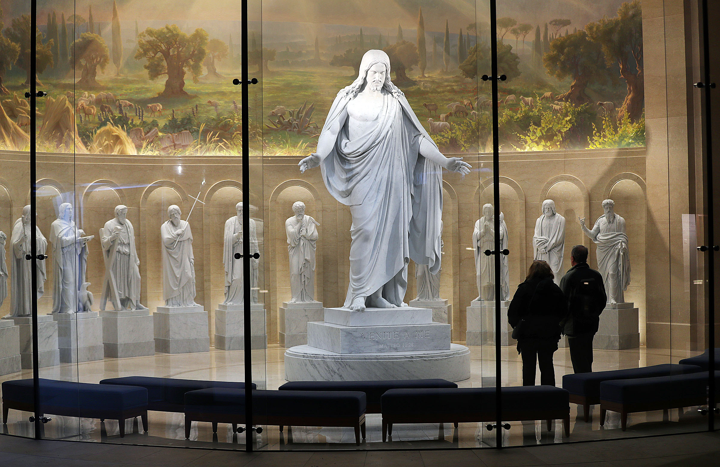 Volunteers Vanna and Benedicto Parisi look at statues of Christ and the Apostles in the Rome Temple Visitors' Center of The Church of Jesus Christ of Latter-day Saints in Rome, Italy, on Sunday, Jan. 13, 2019.