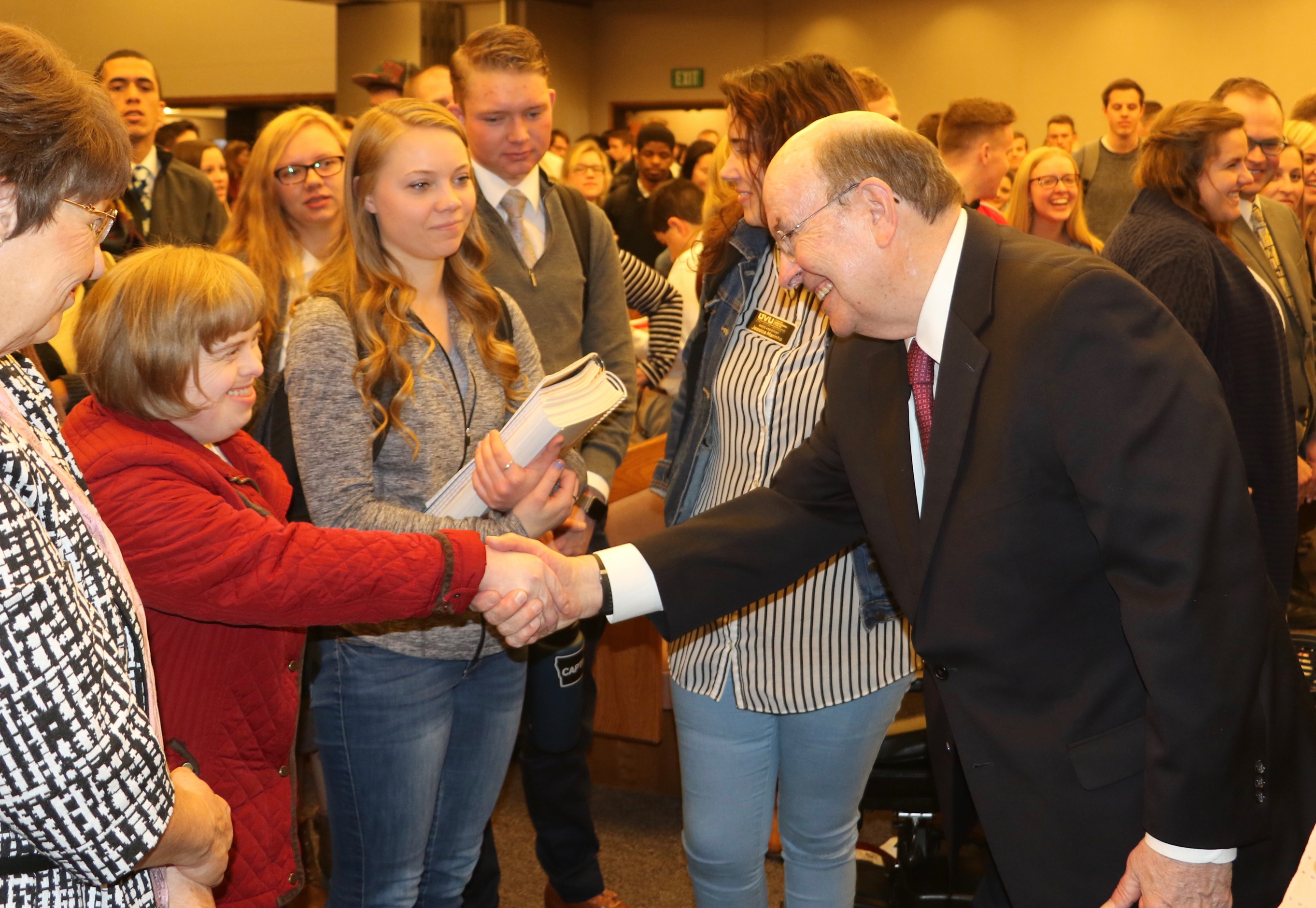 Elder Quentin L. Cook of the Quorum of the Twelve Apostles, shakes hands with staff, faculty and students after a Friday, Feb. 1, 2019, devotional at the Utah Valley Institute on the Utah Valley University campus in Orem, Utah.