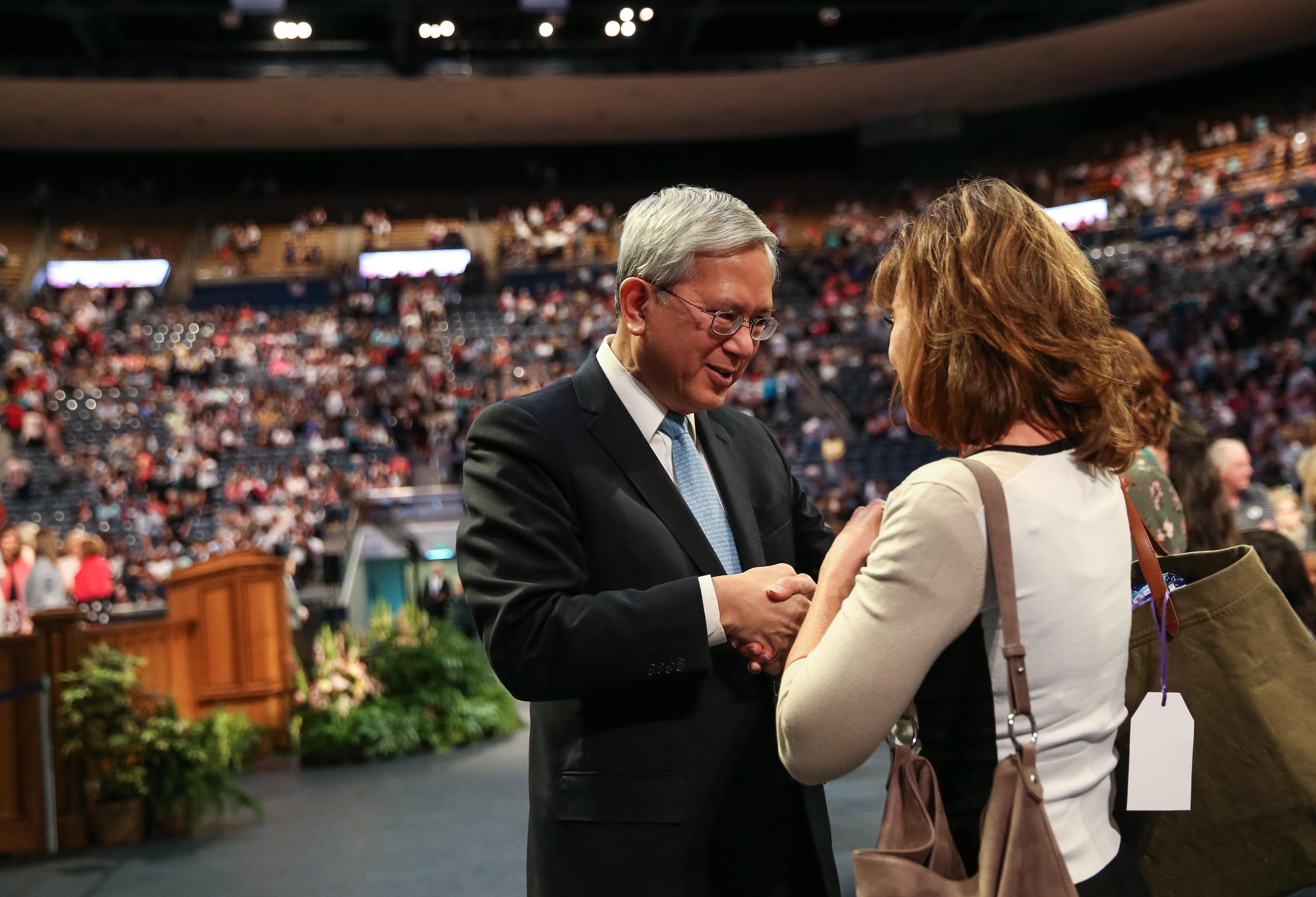 Elder Gerrit W. Gong, of the Quorum of the Twelve Apostles of the LDS Church, greets Peggy Hodson, of Santa Barbara, Calif., after Gong spoke at the BYU Women's Conference at the Marriott Center in Provo on Friday, May 4, 2018.