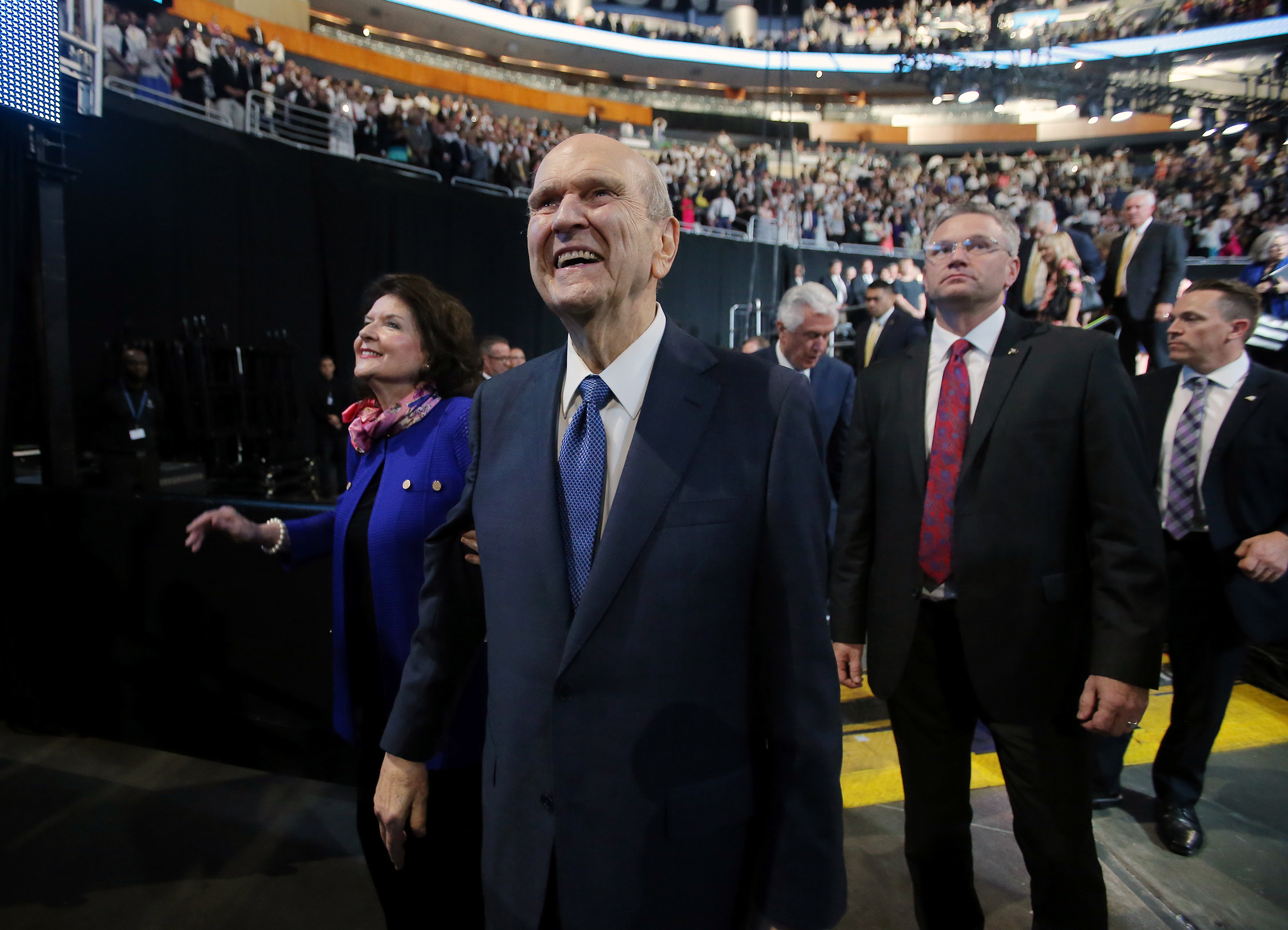 President Russell M. Nelson and his wife, Sister Wendy Nelson, smile as they leave following the June 9, 2019, devotional at the Amway Center in Orlando, Florida.
