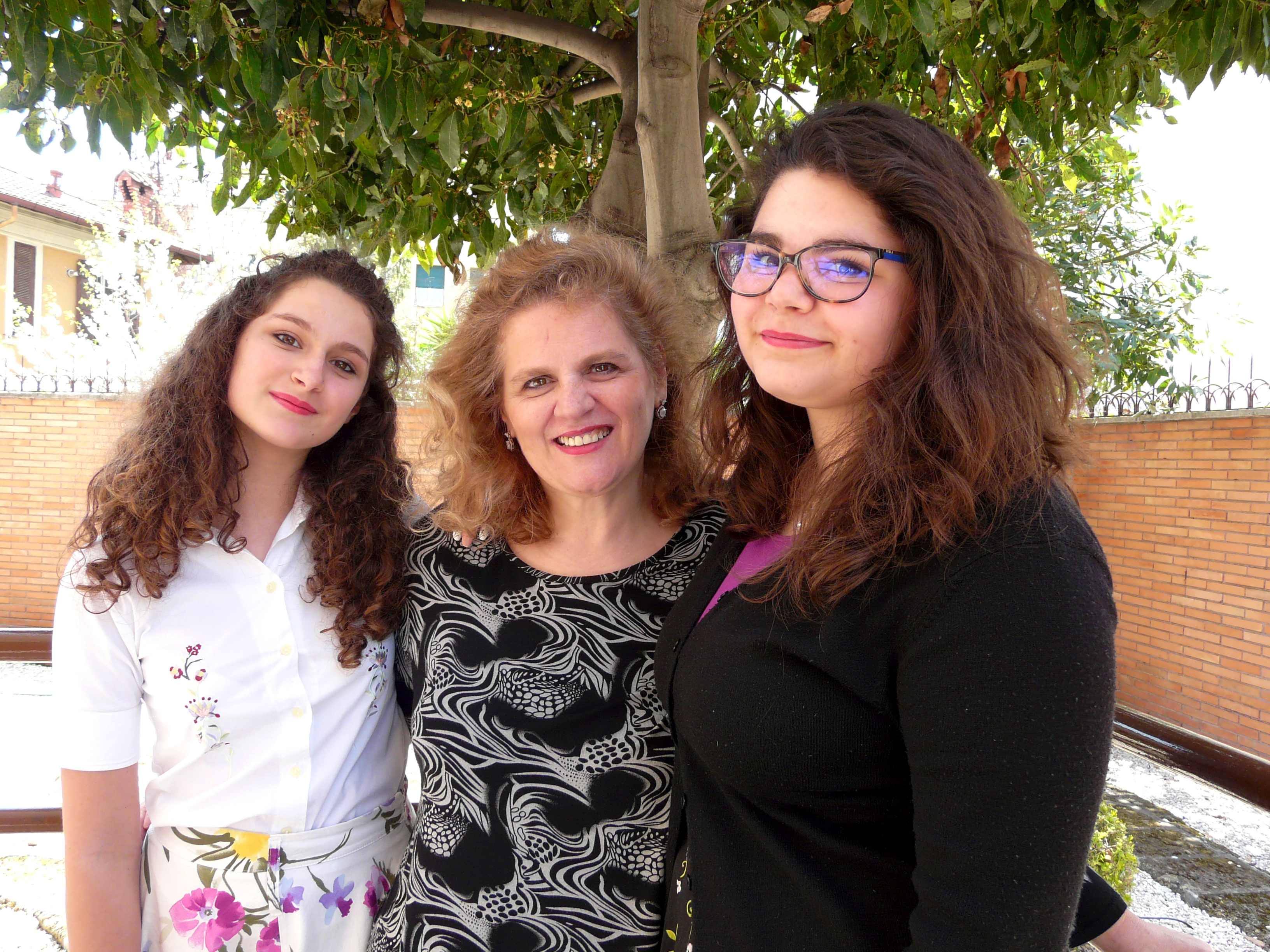 Daughter-in-law Alba Vardeu is flanked by daughters Myriam, 13, left, and Ylenia, 17, both young women in the Rome 2nd Ward.