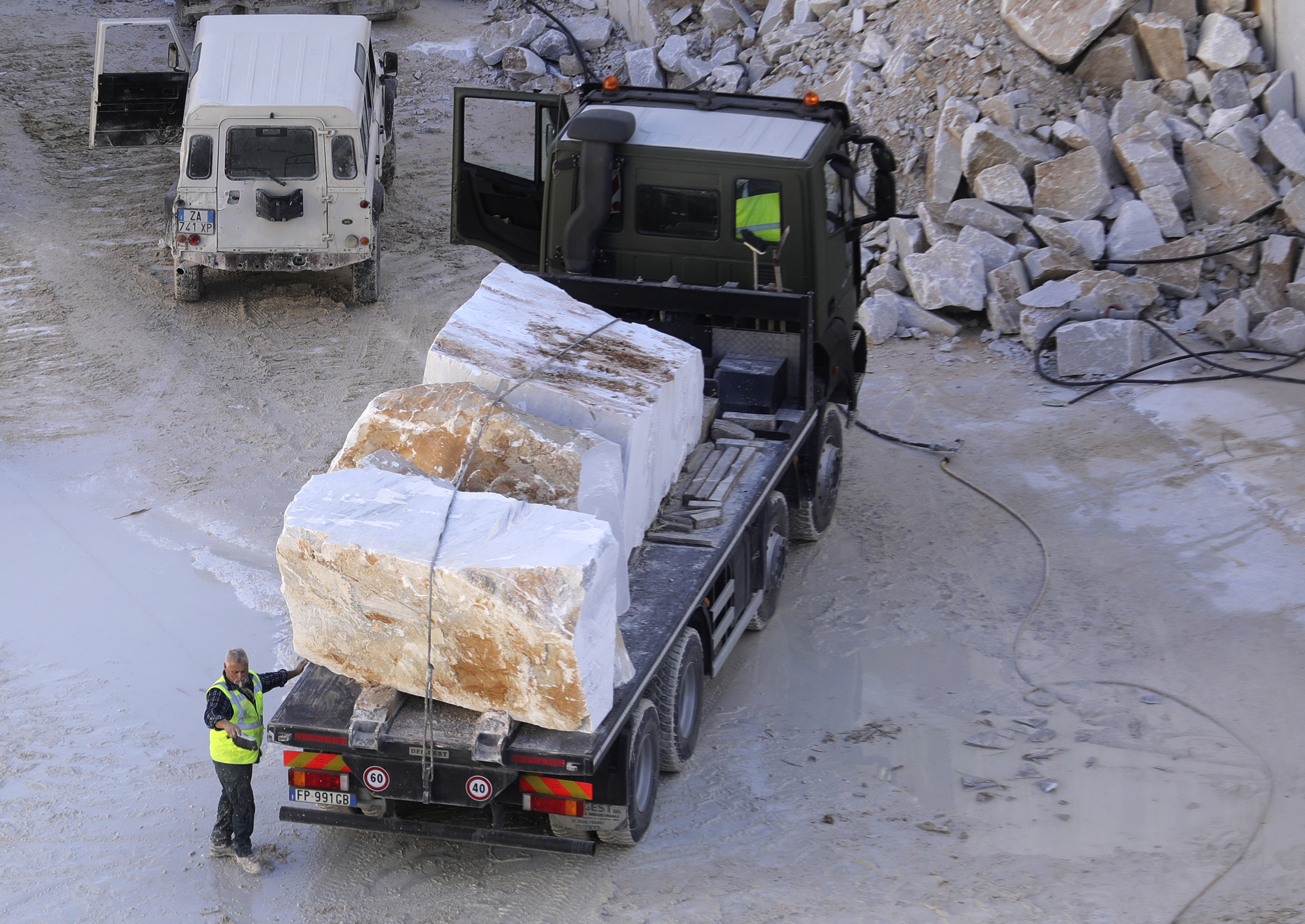 Trucks move marble blocks at a marble quarry in Carrara, Italy, on Thursday, Nov. 15, 2018.