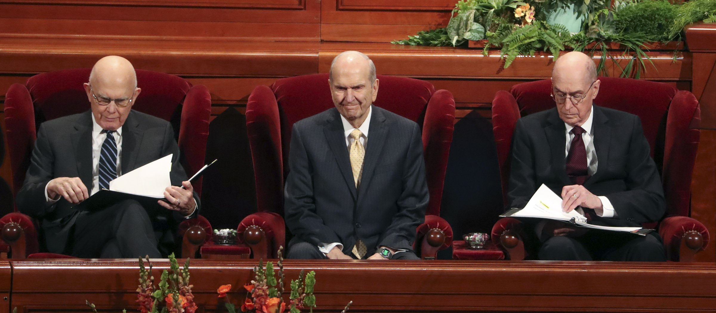 President Russell M. Nelson of The Church of Jesus Christ of Latter-day Saints, center, smiles at attendees as he sits with his counselors, President Dallin H. Oaks, first counselor in the First Presidency, left, and President Henry B. Eyring, second counselor in the First Presidency, right, at the Conference Center in Salt Lake City during the afternoon session of 189th Annual General Conference on Saturday, April 6, 2019.