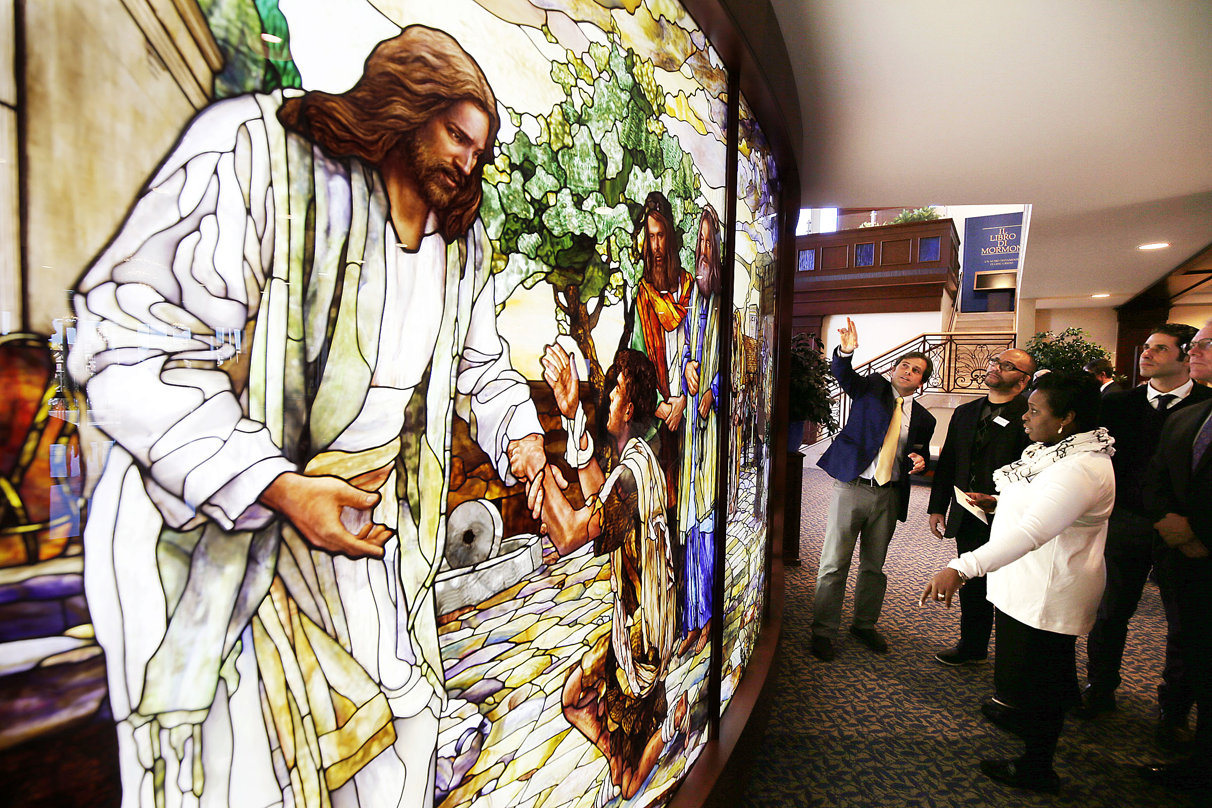 Tom Holdman, center left, of Holdman Studios, discusses his company's stained glass work with Pastor Chris Zacharias and his wife, Kim, of the John Wesley A.M.E. Zion Church during a tour of the Rome Italy Temple and the Rome Italy Temple Visitors' Center on Tuesday, Jan. 15, 2019.