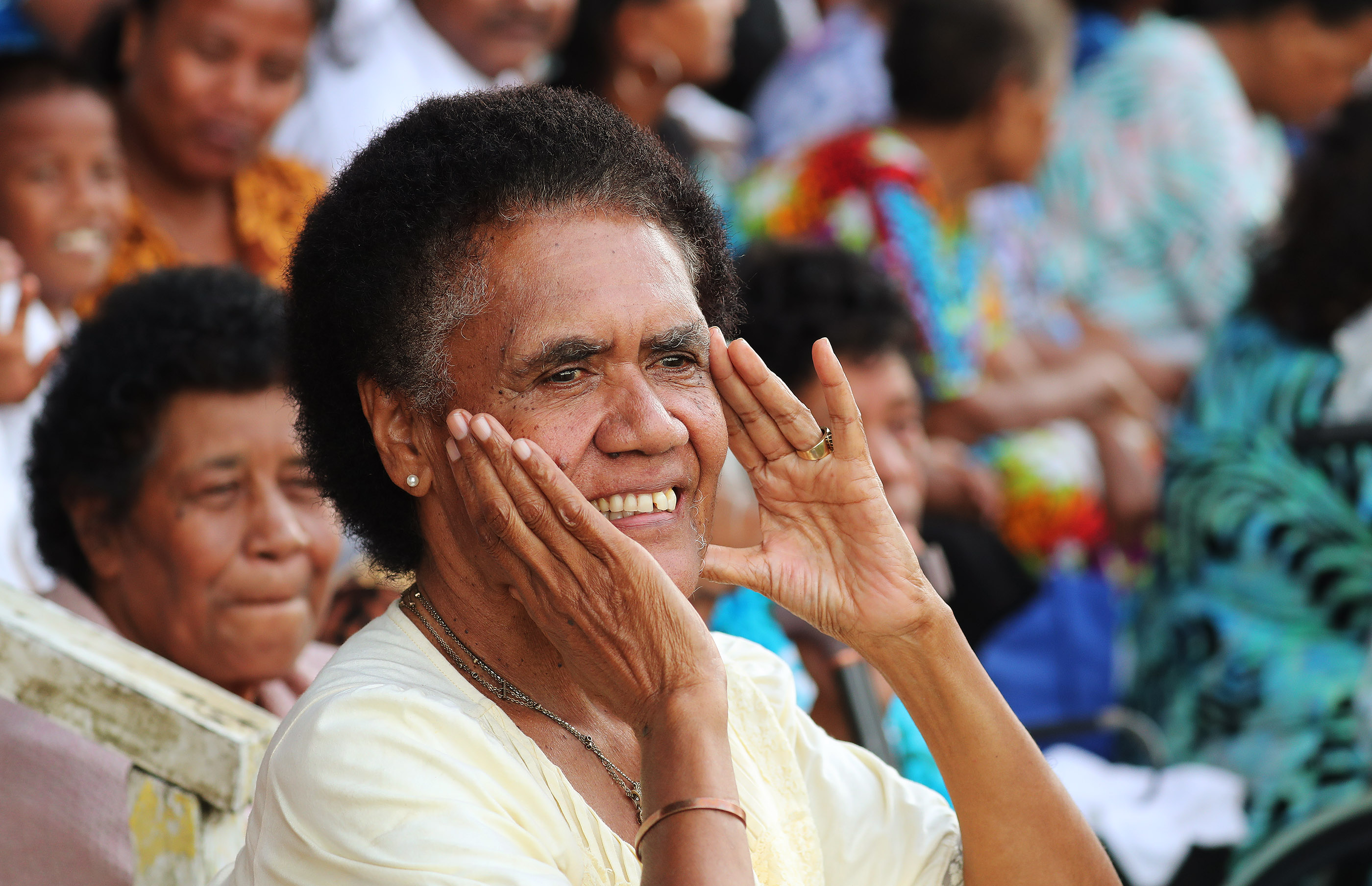 Jis Eseta DiLoi listens to President Russell M. Nelson of The Church of Jesus Christ of Latter-day Saints speaking during a devotional at Ratu Cakobau Park stadium in Nausori, Fiji, on May 22, 2019.