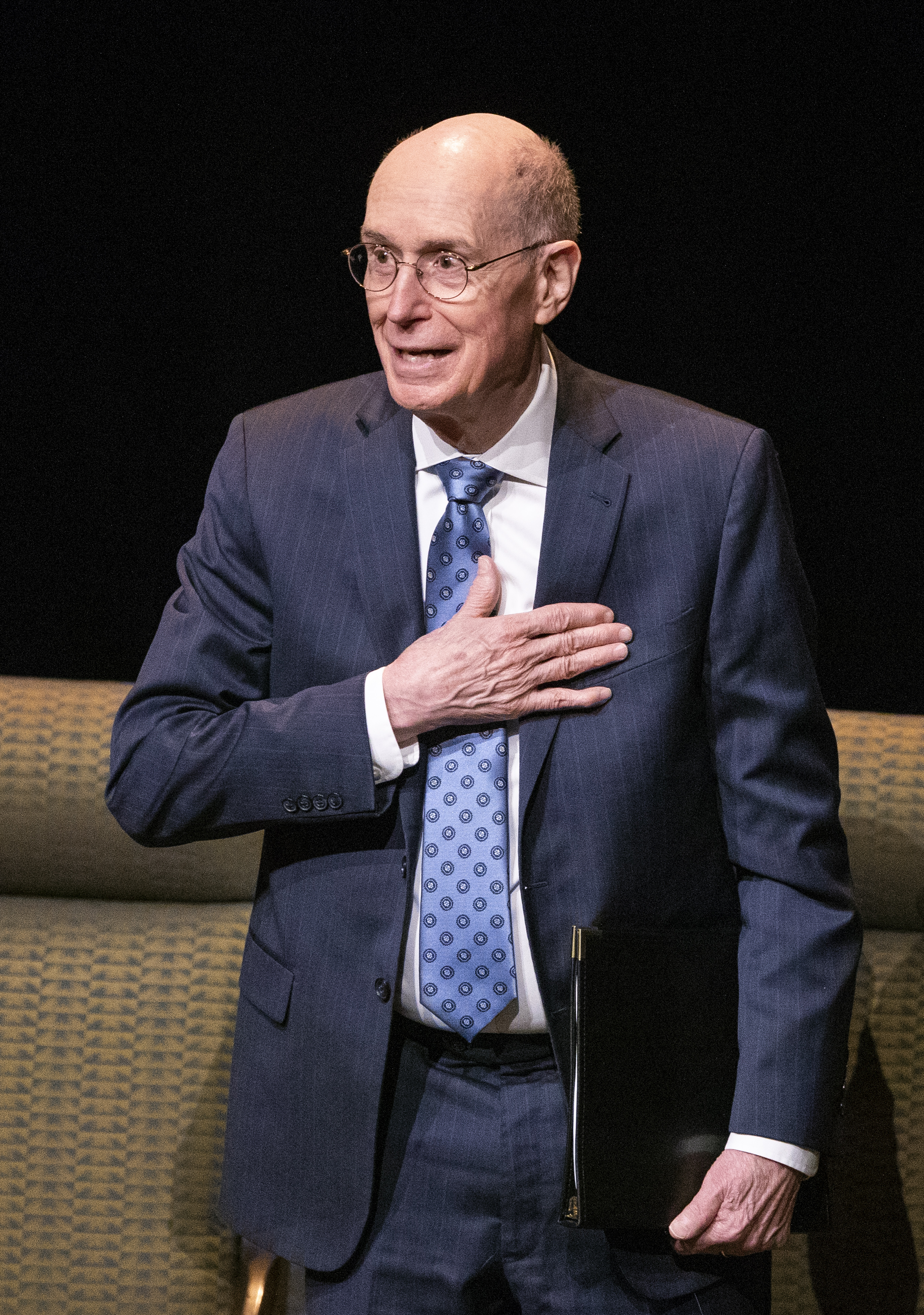 President Henry B. Eyring acknowledges the crowd as he exits after speaking to LDS Business College students at a devotional in the Conference Center Theater in Salt Lake City on Tuesday, Nov. 6, 2018.