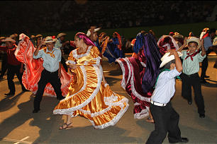 Young Latter-day Saint Salvadorans pay tribute to their rich cultural history by performing a colorful and animated folk dance. The culture event included cast members from stakes across El Salvador. The young performers spent months practicing and rehearsing to prepare for the historic evening.