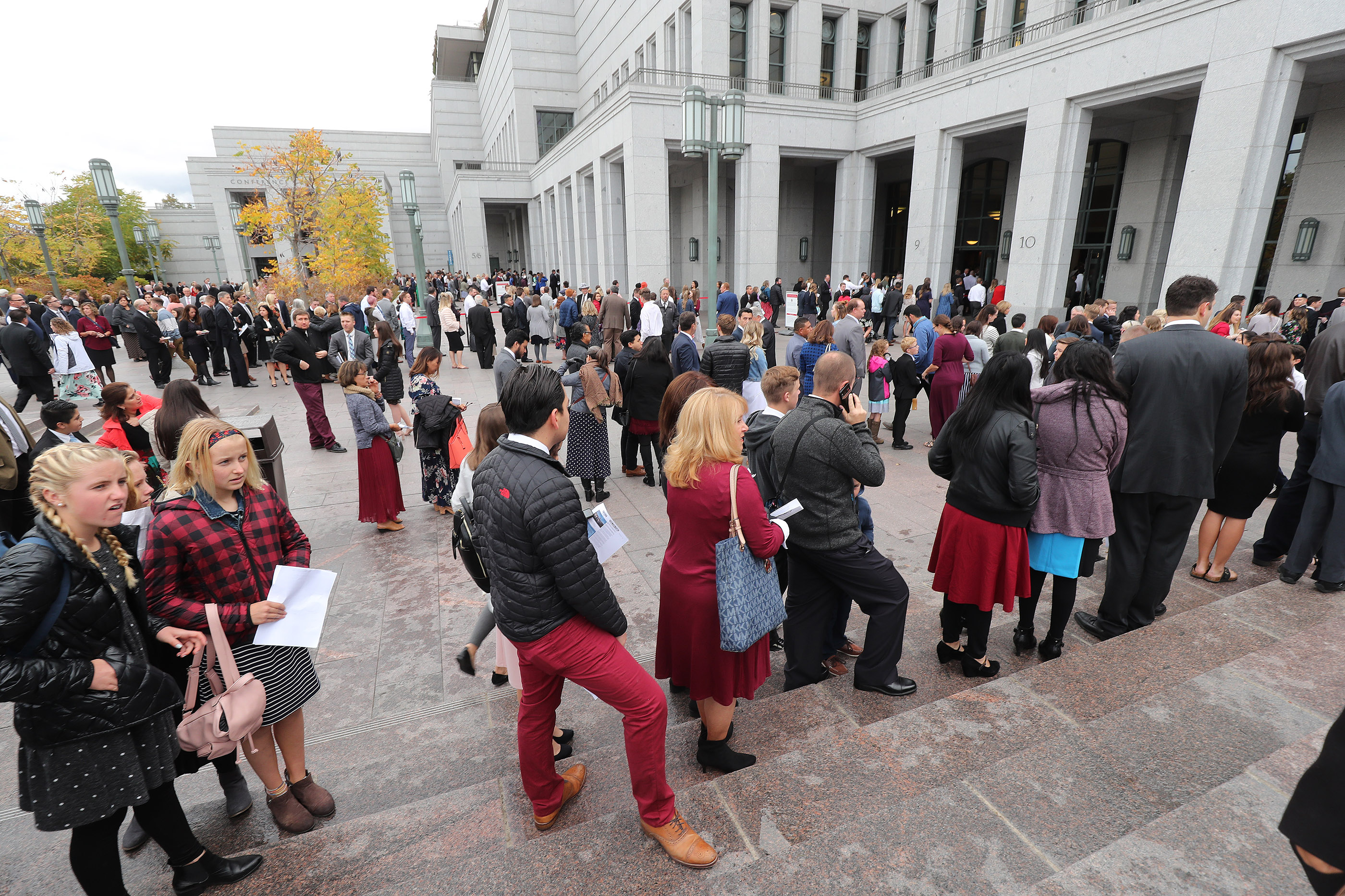 Attendees stand in line for the 188th Semiannual General Conference of The Church of Jesus Christ of Latter-day Saints in Salt Lake City on Sunday, Oct. 7, 2018.
