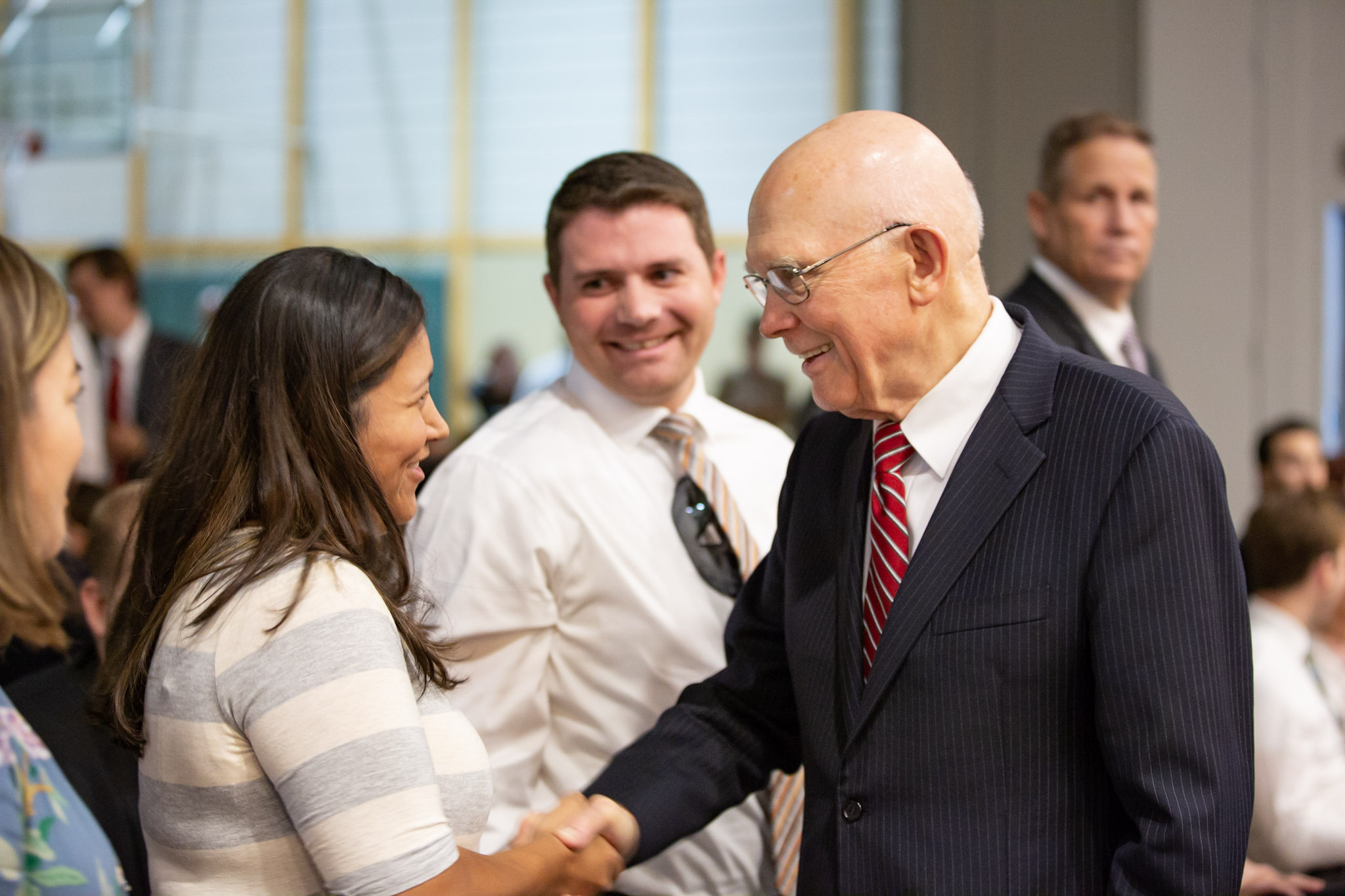 President Dallin H. Oaks, first counselor in the First Presidency, greets members of a capacity congregation of young married couples from nine stakes in the Los Angeles area before a devotional, held in the Los Angeles California Santa Monica Stake Center on Friday, Aug. 24, 2018.