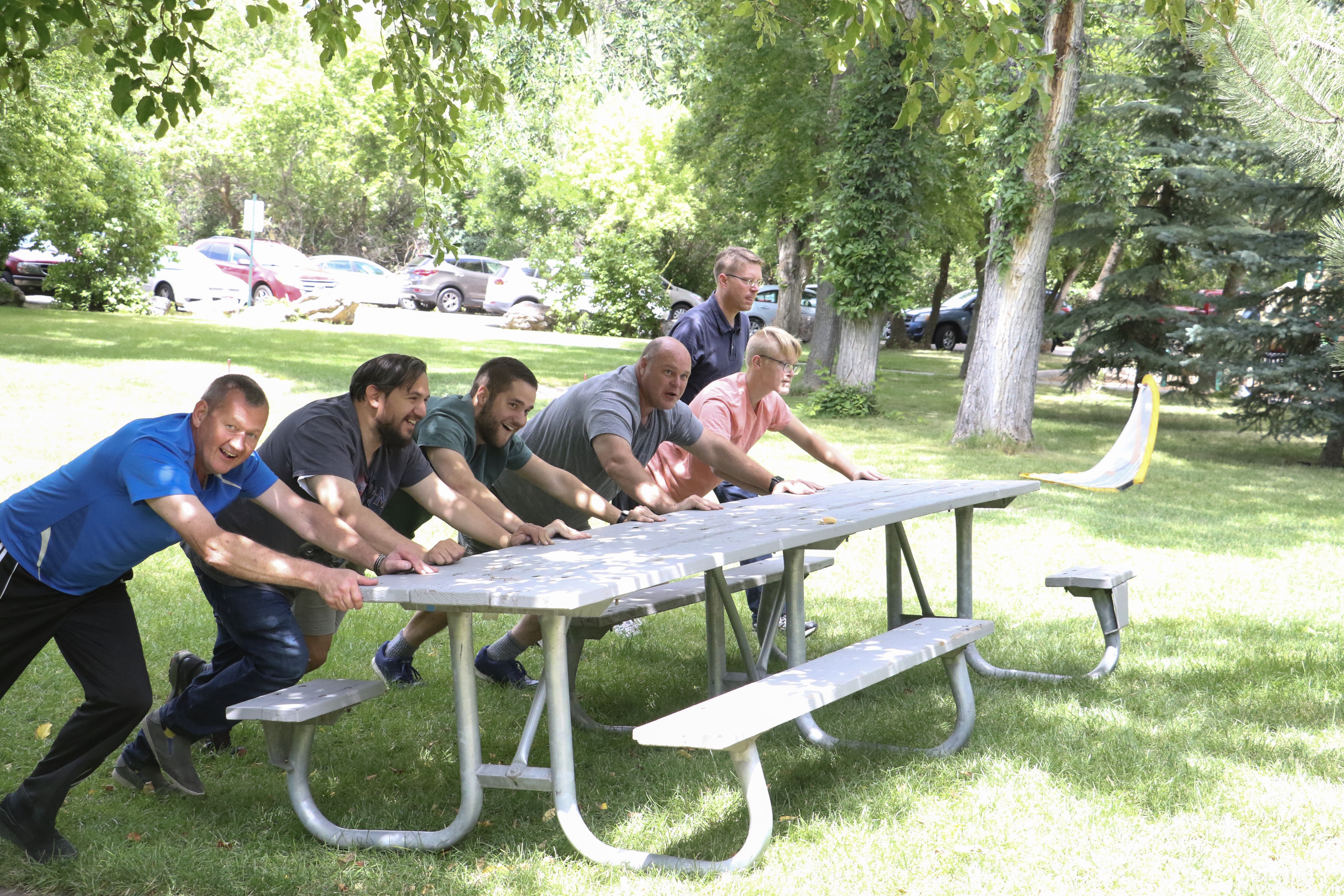 German Speaking Ward picnic-goers work together to get set up for the activities on July 13, 2019 at Washington Terrace Park in Parley's Canyon, Utah, on July 13, 2019.