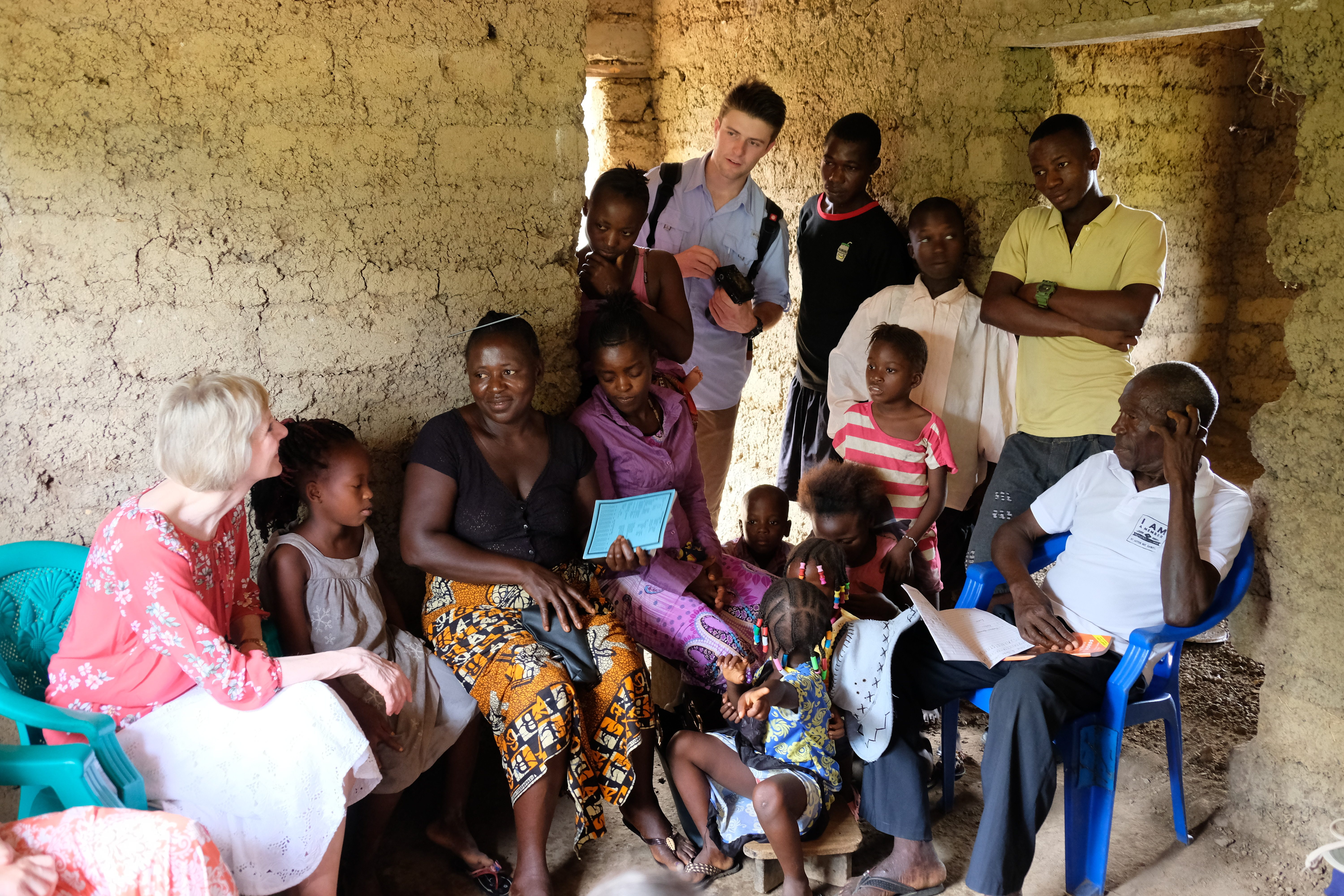 Sister Jean B. Bingham visits with member families in Sierra Leone while visiting to observe the implementation of the Gospel Literacy program. Sister Bingham, Relief Society general president, visited the West African country June 5 through June 16, 2019.