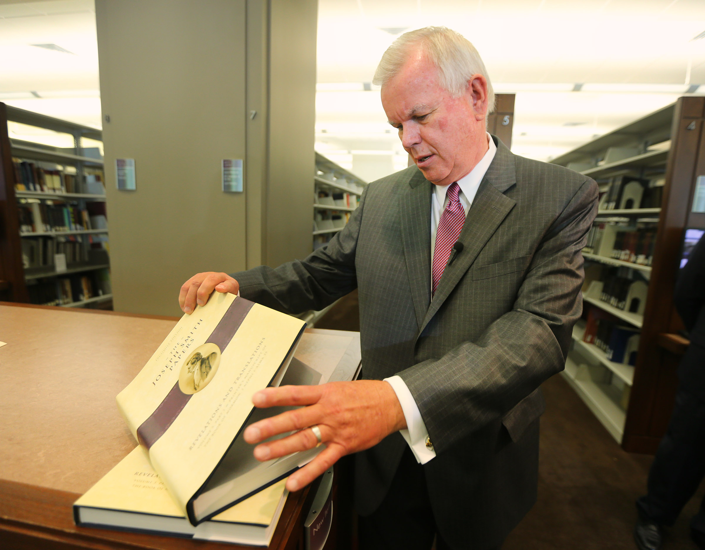 Church Historian and Recorder Elder Steven E. Snow shows a few of the pages of the new volume as The Church of Jesus Christ of Latter-day Saints, in cooperation with the Community of Christ church, announces the release of the printer's manuscript of the Book of Mormon, during a press conference Tuesday, Aug. 4, 2015, at the Church History Library in Salt Lake City.