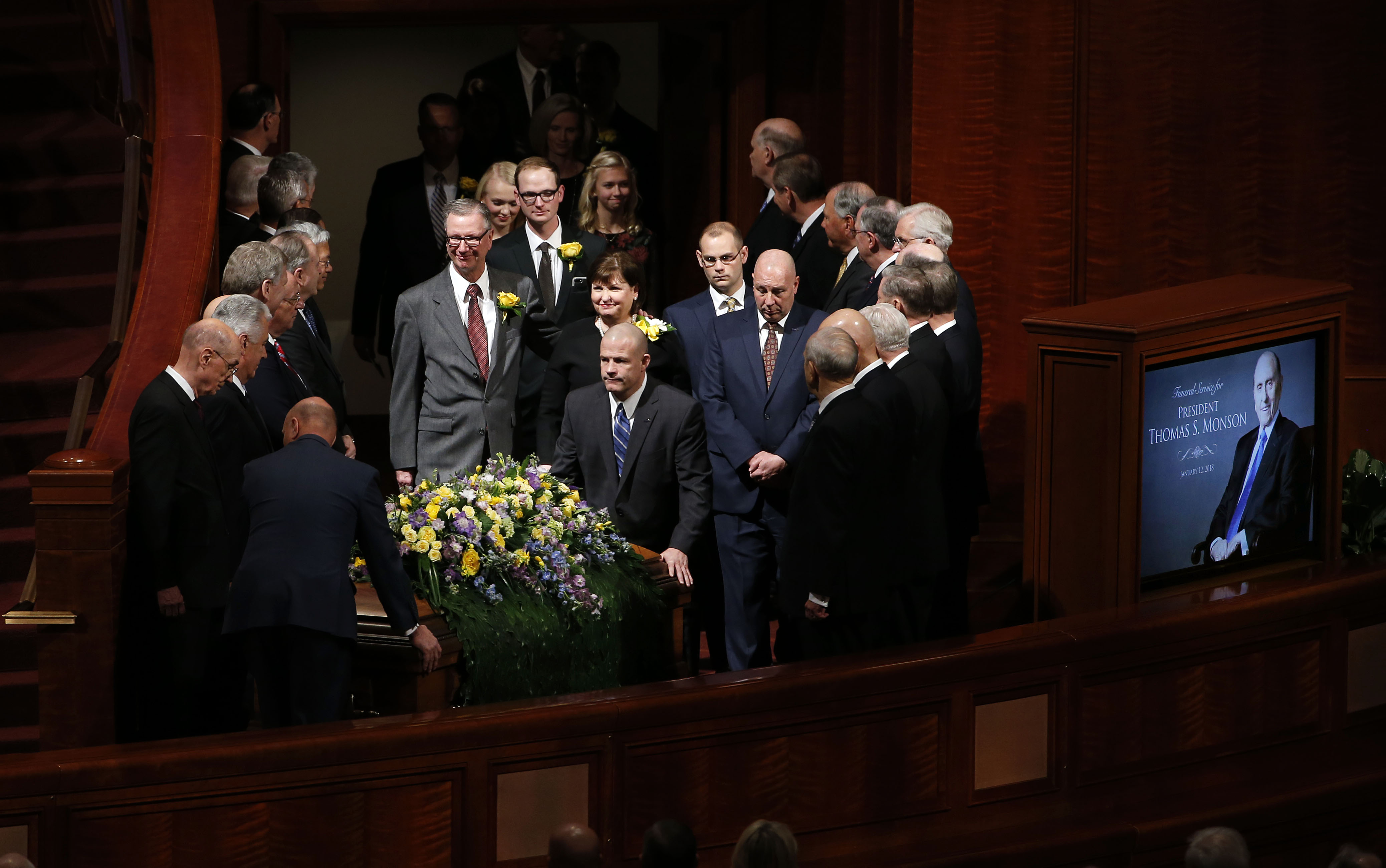 Church President Thomas S. Monson's casket is brought into the Conference Center in Salt Lake City on Friday, Jan. 12, 2018.