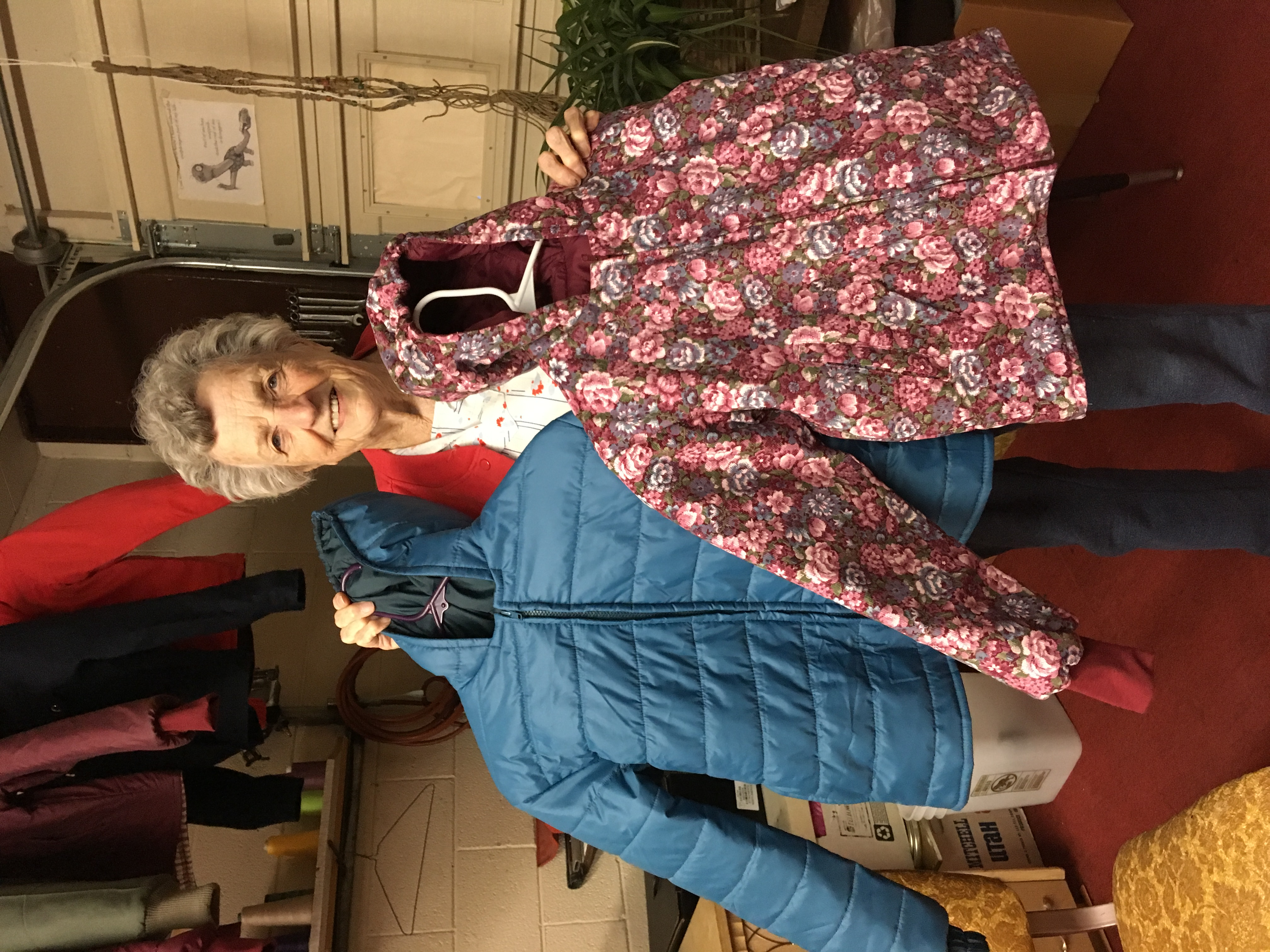 Betty Luke displays two of her handmade winter coats which she donates to the Richfield Humanitarian Center.