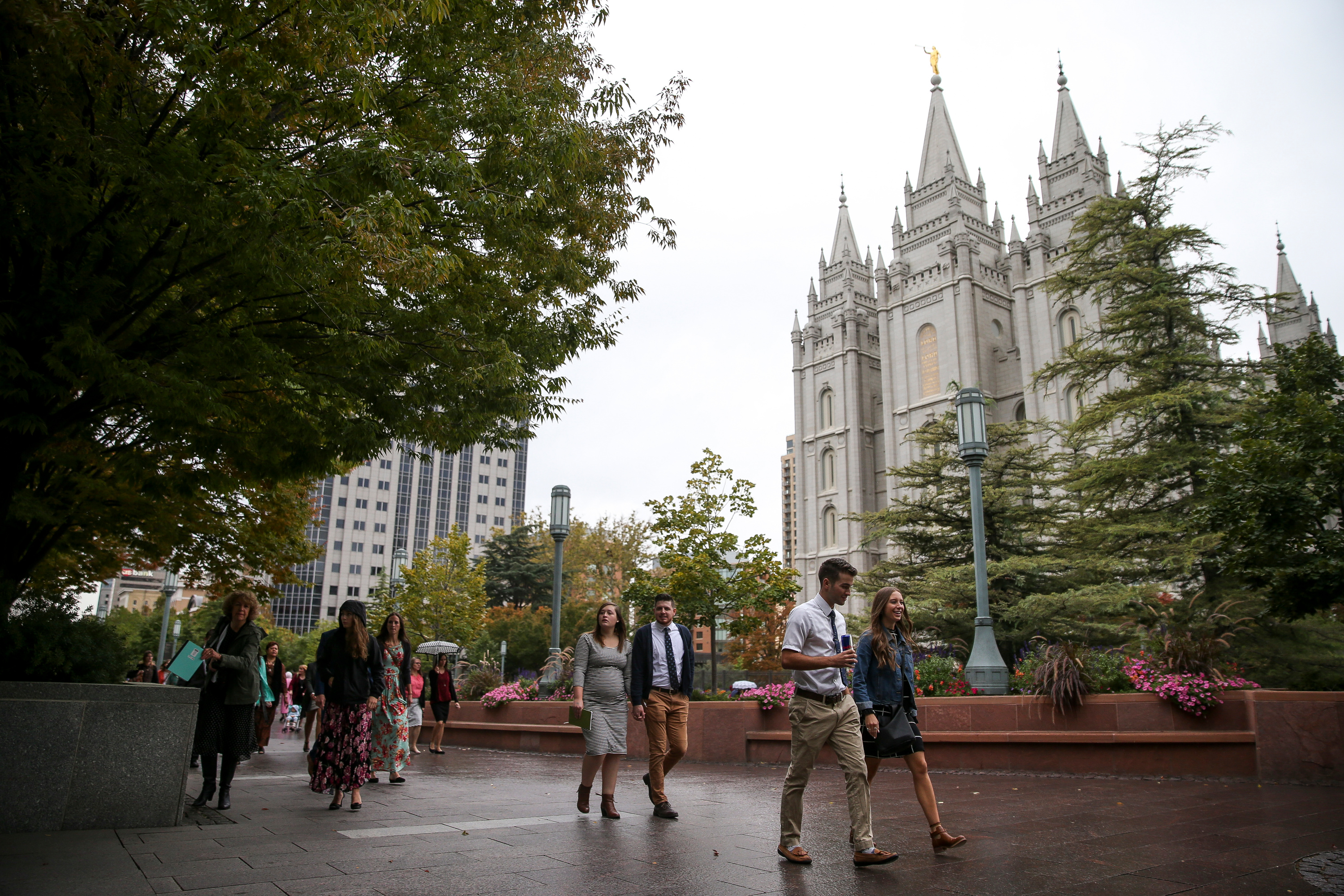 People walk past the Salt Lake Temple on the way to the Conference Center before the Saturday morning session of the Church's 187th Semiannual General Conference in Salt Lake City on Saturday, Sept. 30, 2017.
