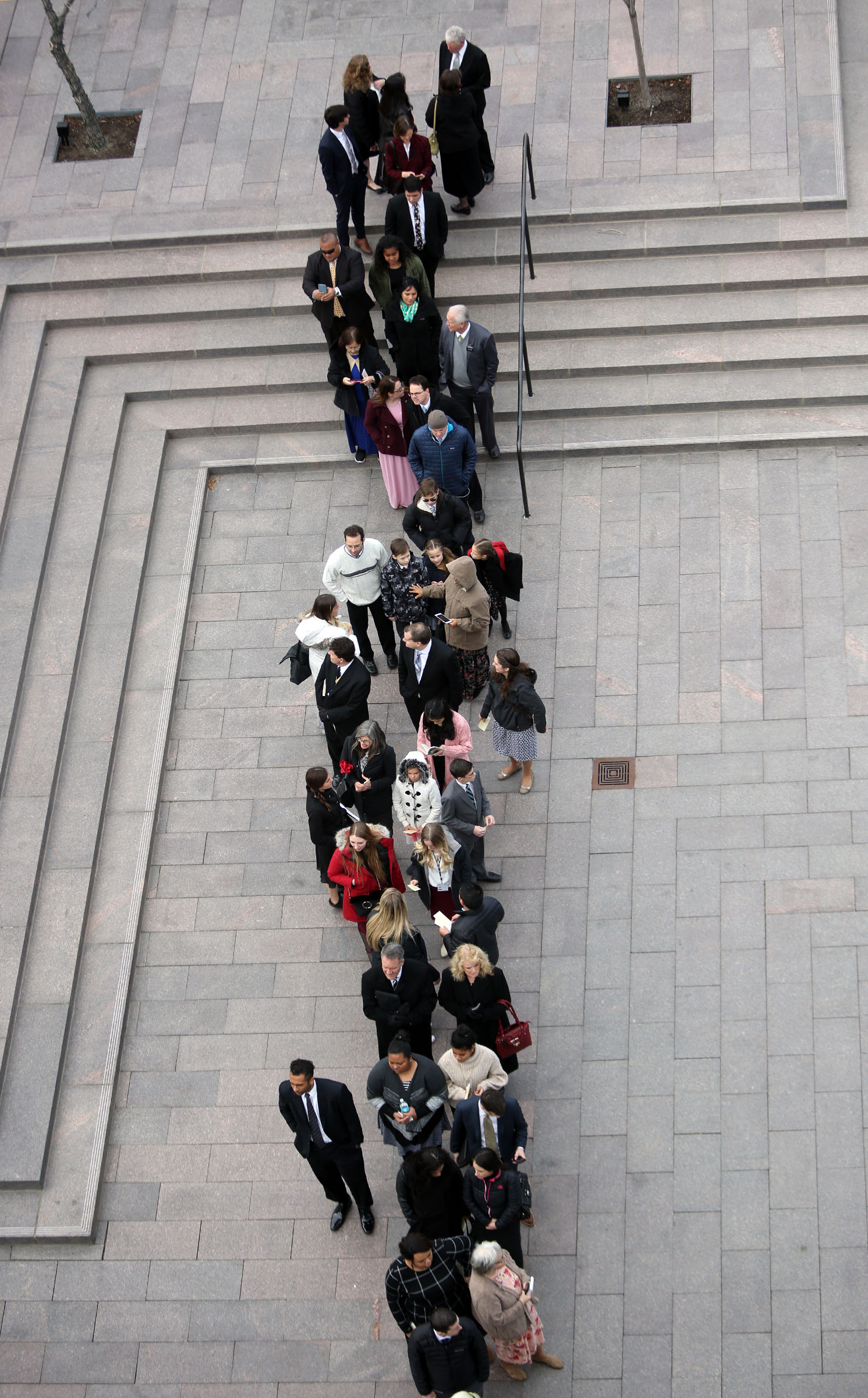 People line up for Church President Thomas S. Monson's funeral at the Conference Center in Salt Lake City on Friday, Jan. 12, 2018.
