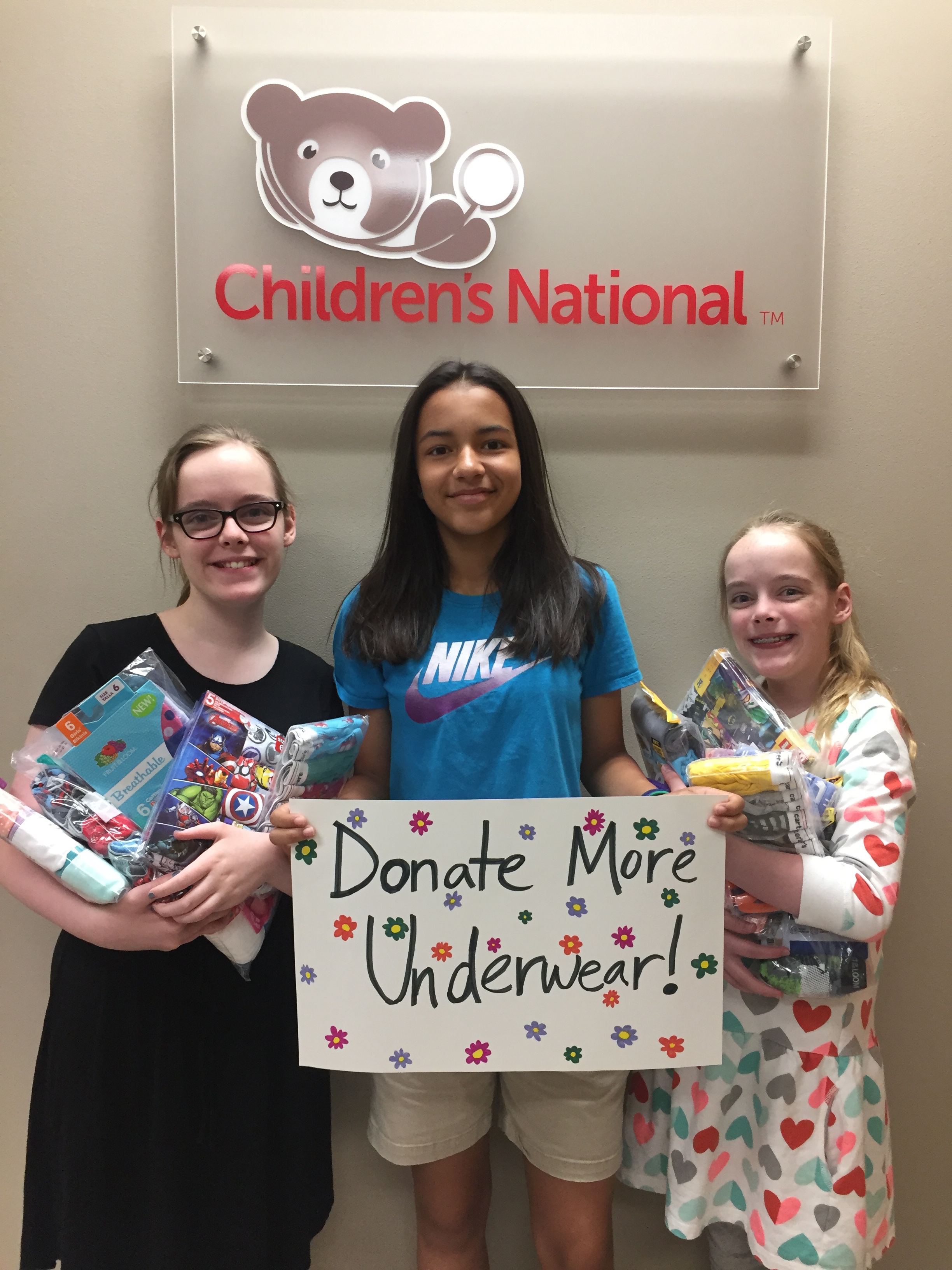 From left: Sofia Atkinson, Isabel Marchena and Mirabel Atkinson pose in the Children's National Medical Center. The girls collected more than 7,000 pairs of underwear which they then donated to the medical center.