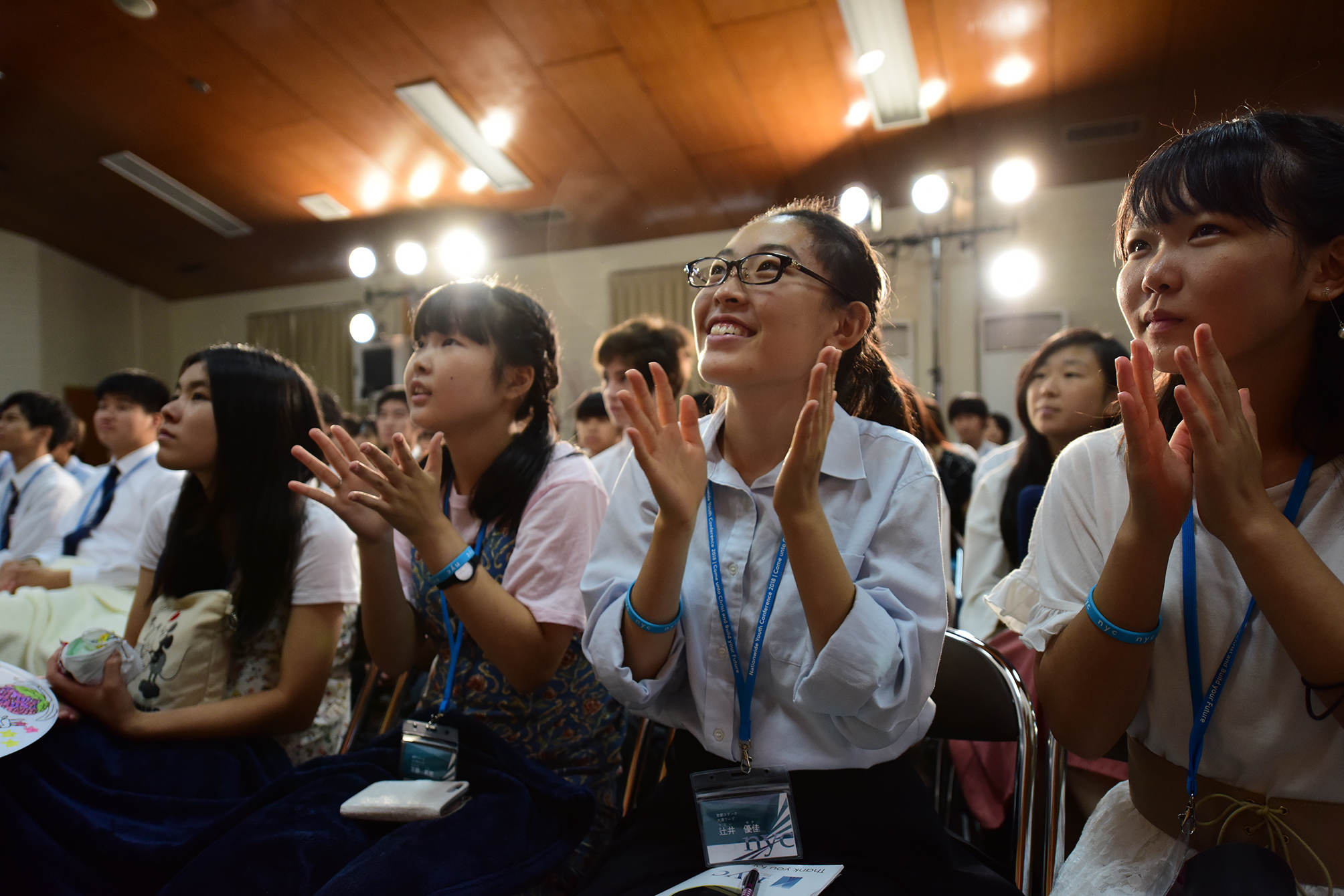 Youth in Japan listen during a Face to Face event with Elder Gary E. Stevenson of the Quorum of the Twelve Apostles and his wife, Sister Lesa Stevenson, on Aug. 14.