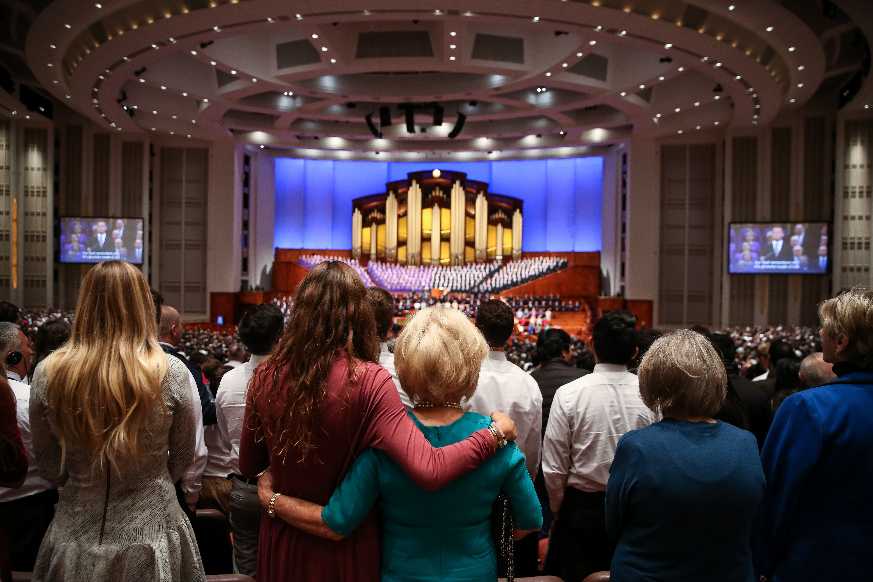 Conferencegoers rise in song during the Saturday morning session of the 188th Semiannual General Conference of The Church of Jesus Christ of Latter-day Saints in the Conference Center in Salt Lake City on Saturday, Oct. 6, 2018.
