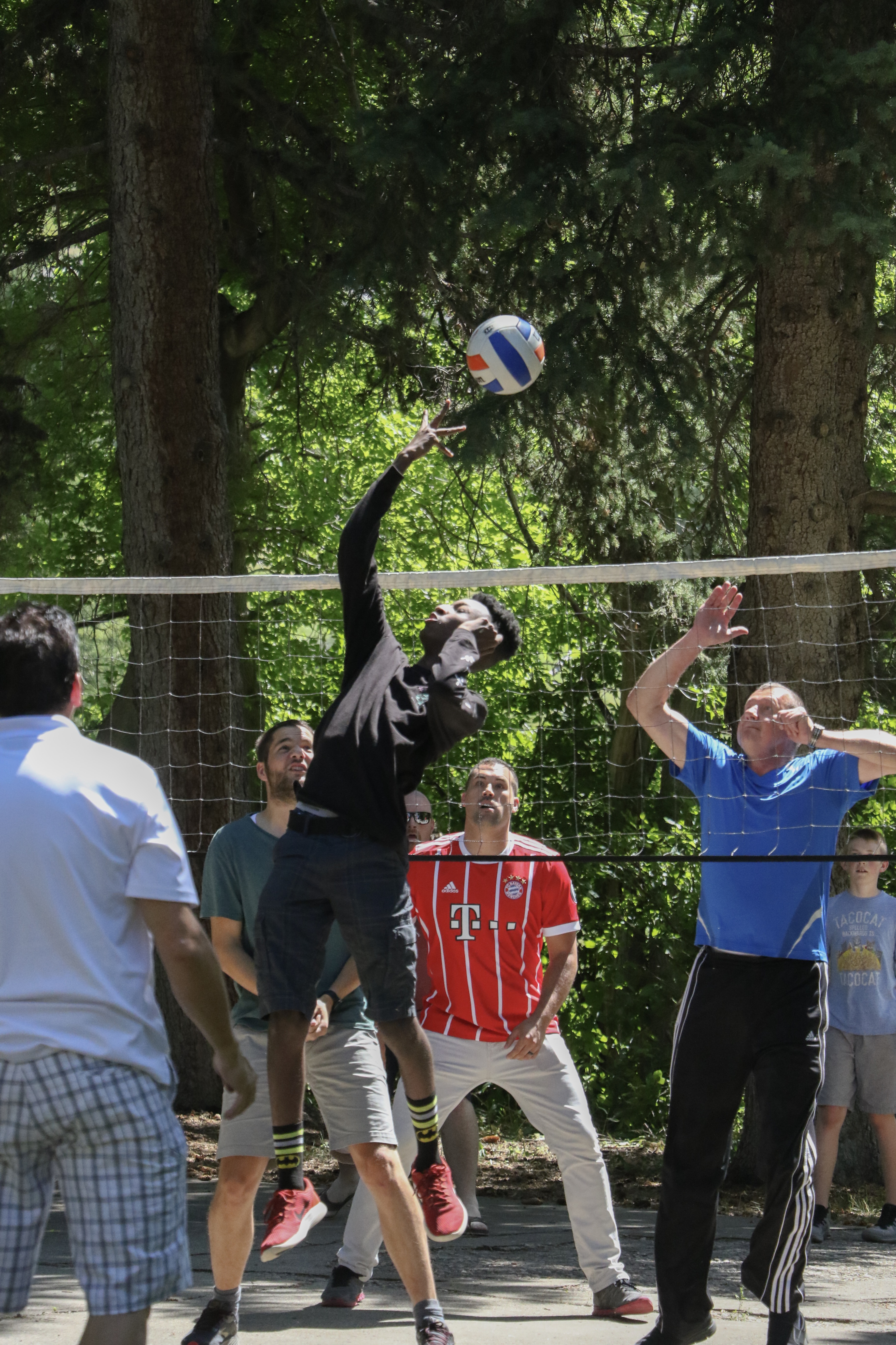 Members of the German Speaking Ward and family and friends play volleyball at the annual ward picnic at Washington Terrace Park in Parley's Canyon, Utah, on July 13, 2019.