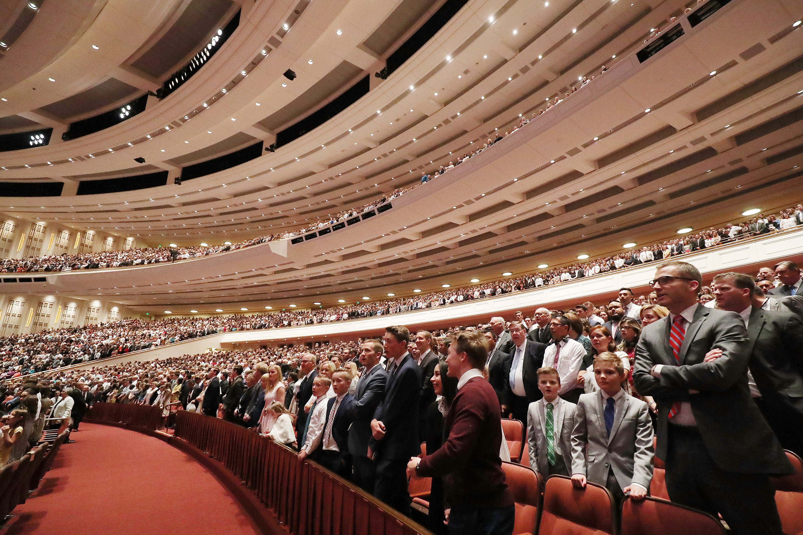 Conferencegoers sing a congregational hymn during the 189th Annual General Conference of The Church of Jesus Christ of Latter-day Saints in Salt Lake City on Sunday, April 7, 2019.